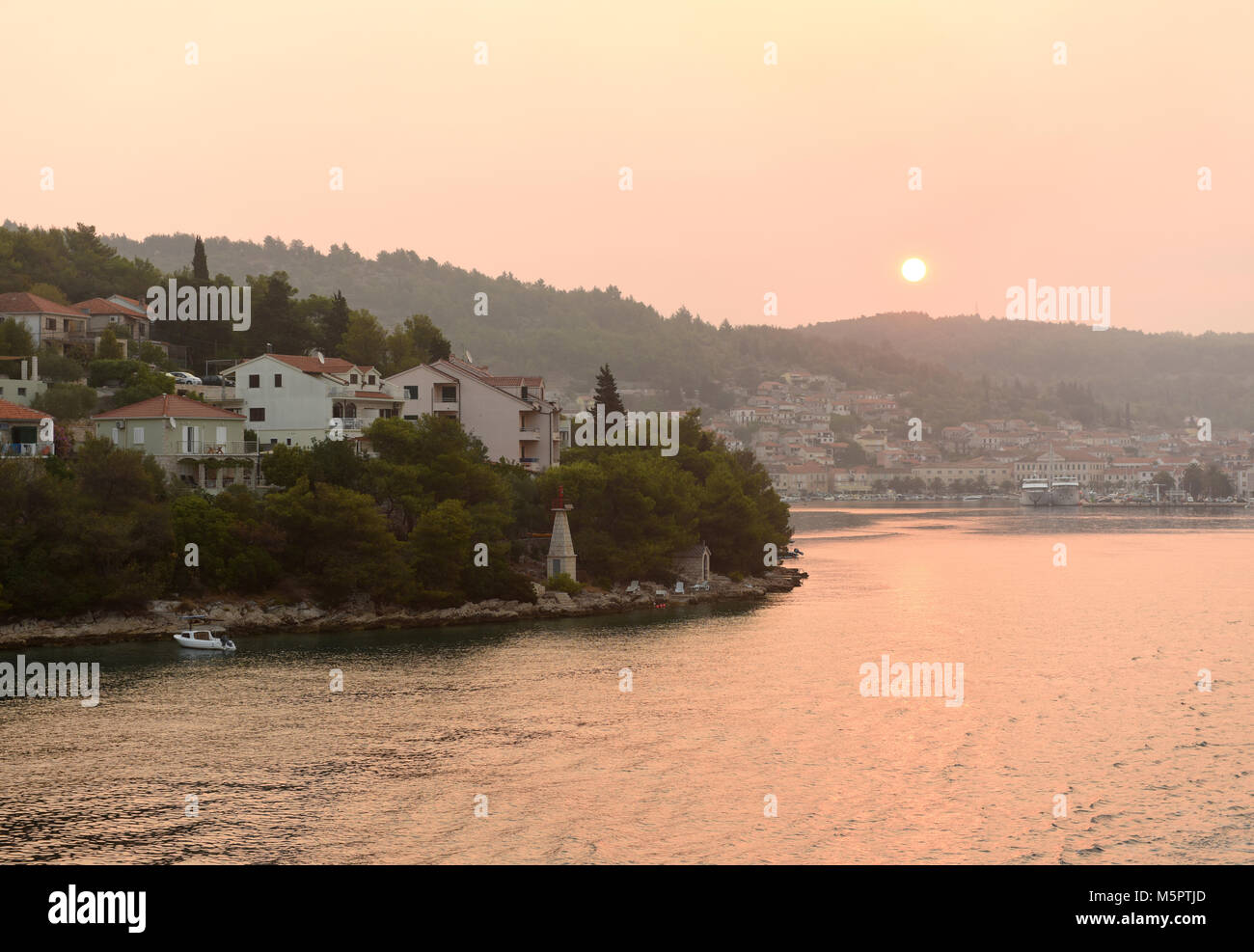 Sunrise in Vela Luka on island Korcula, Croatia. - Stock Image