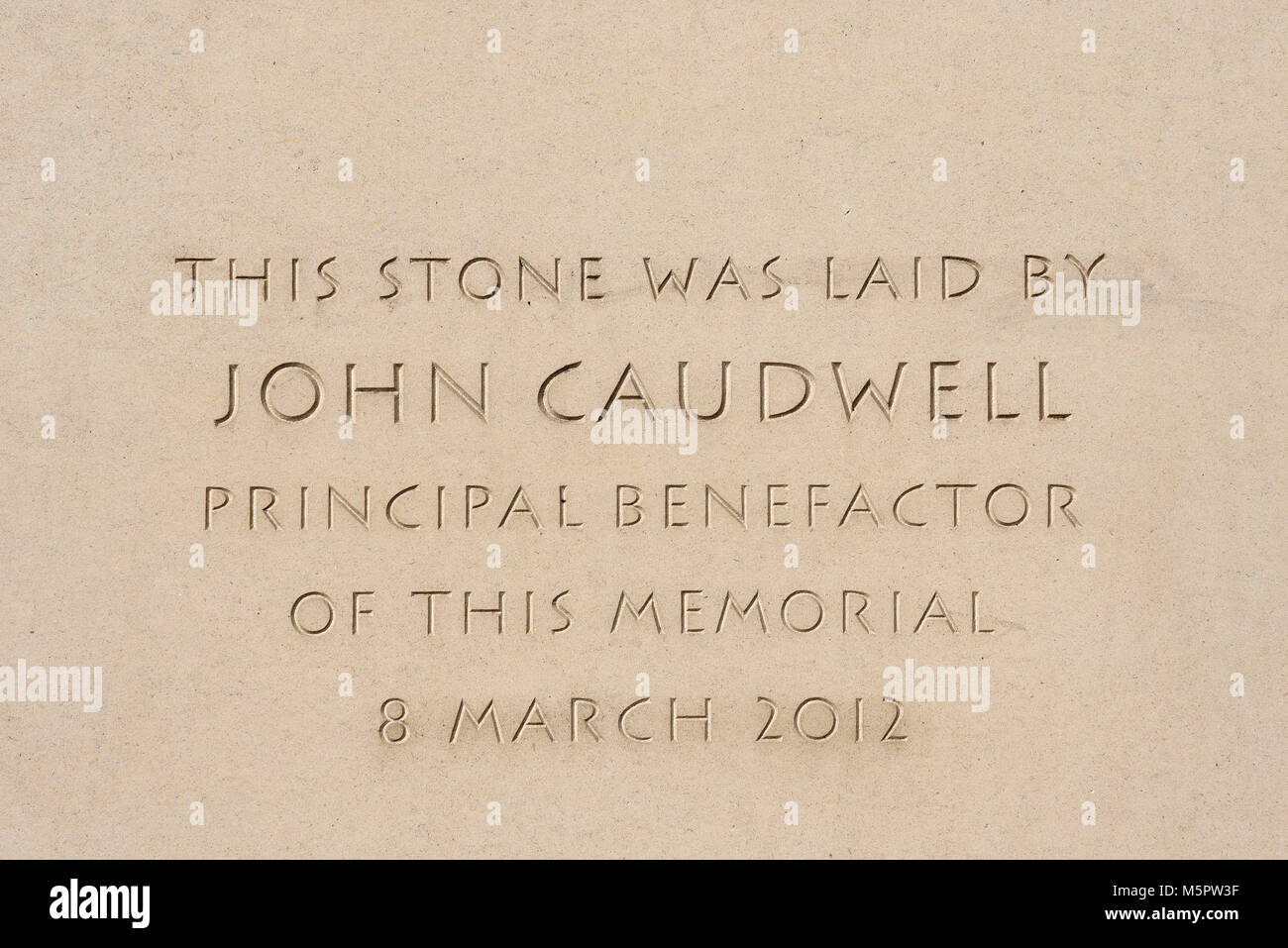 Bomber Command Memorial in Green Park, London, UK. Carved detail dedicating John Caudwell principal benefactor. - Stock Image