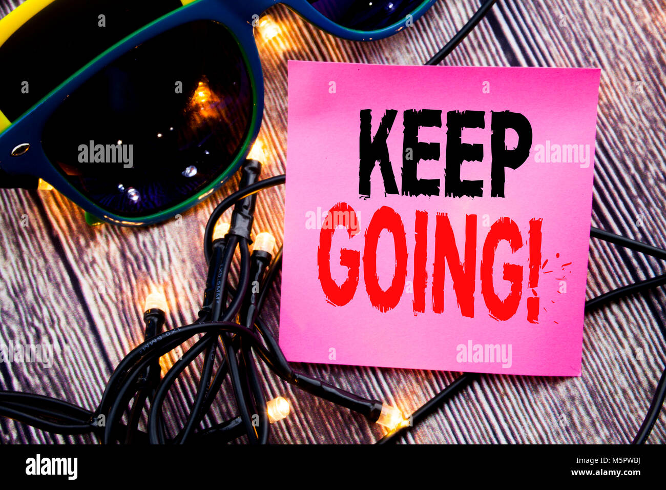 Hand writing text caption showing Keep Going. Business concept for Go Moving Forward Letting written on the wood Stock Photo