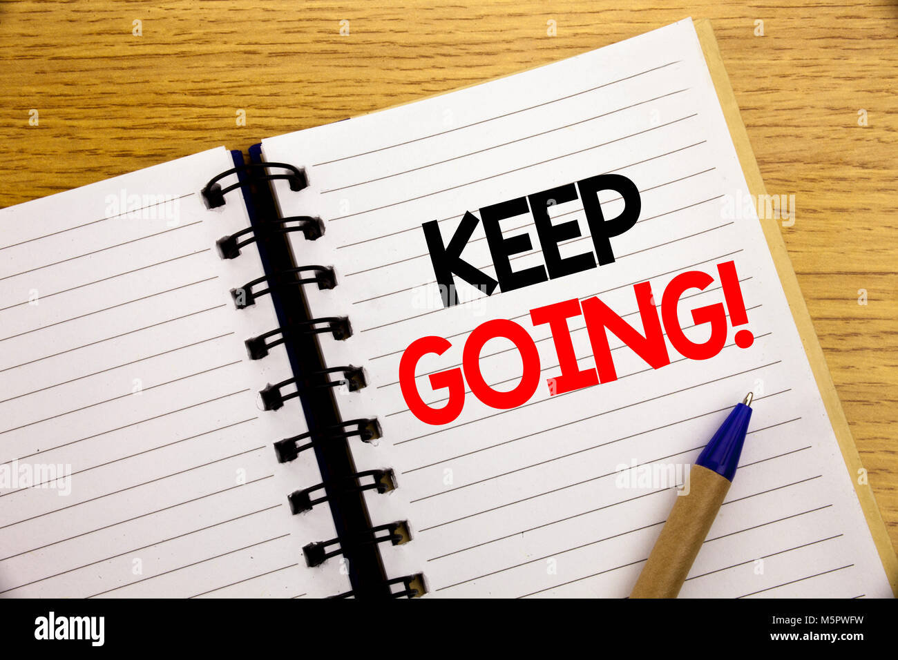 Word, writing Keep Going. Business concept for Go Moving Forward Letting written on notepad with space on old wood Stock Photo