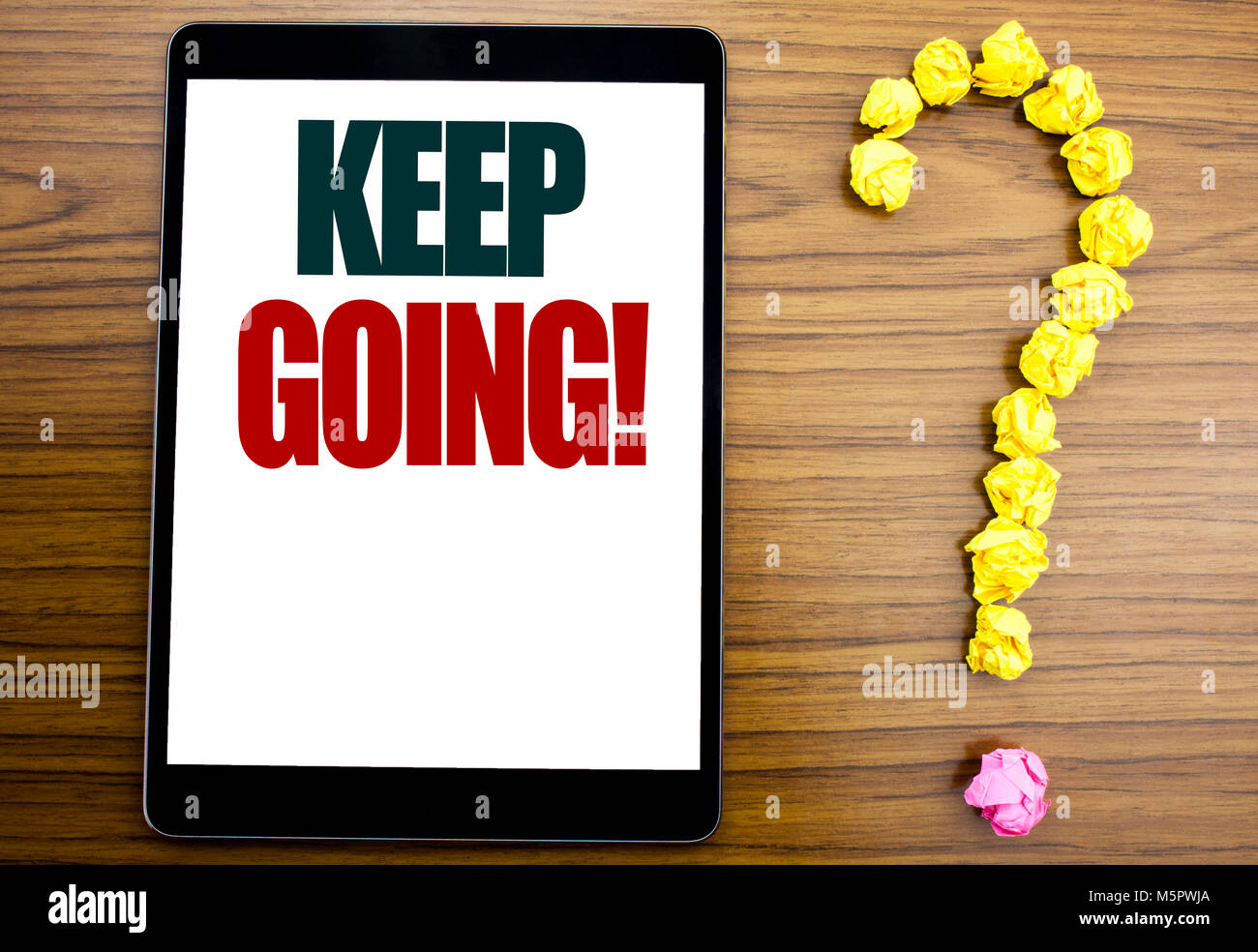 Word, writing Keep Going. Business concept for Go Moving Forward Letting Written on tablet, background with question - Stock Image