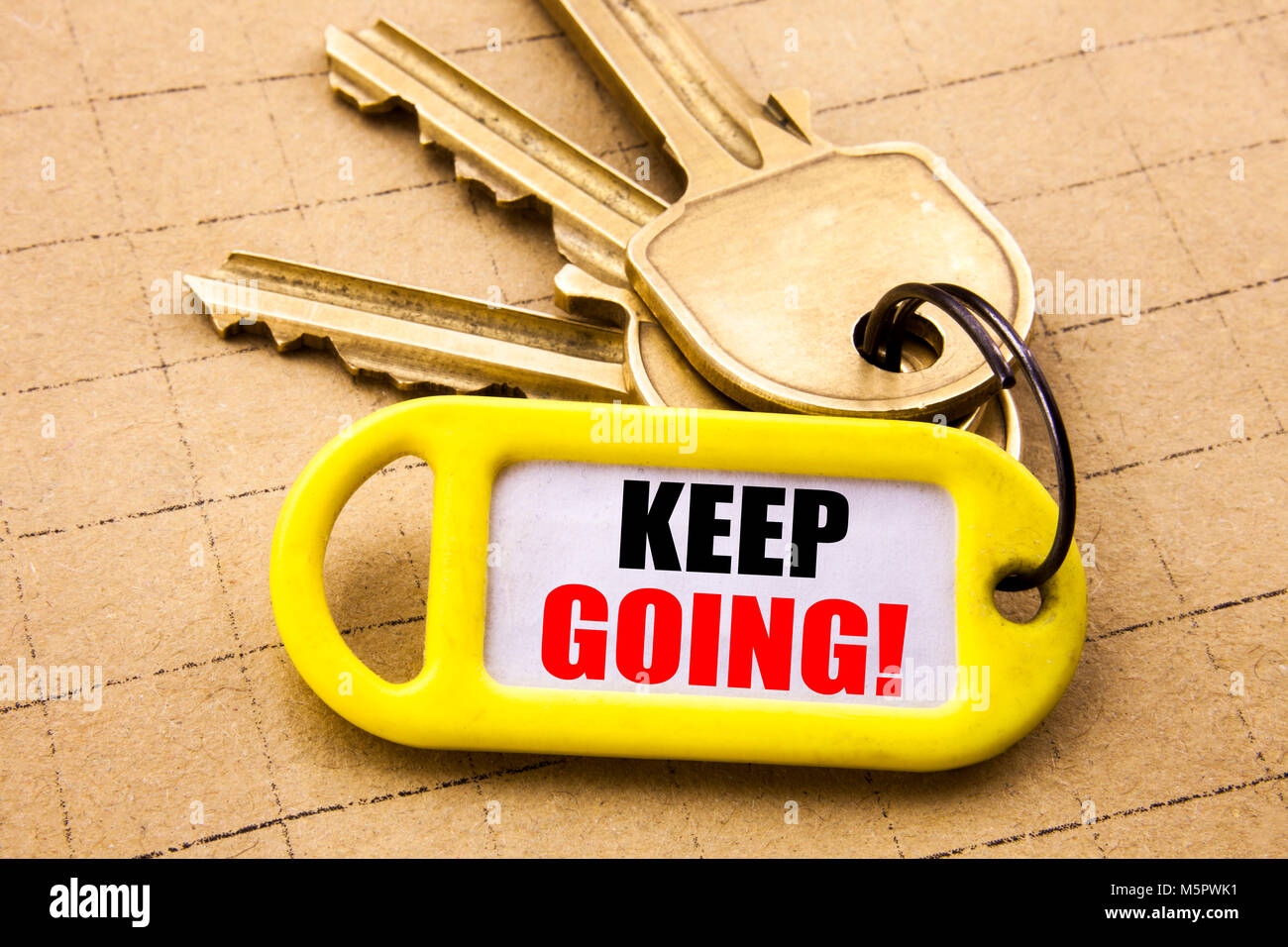 Word, writing Keep Going. Business concept for Go Moving Forward Letting Written on key holder, close up. - Stock Image
