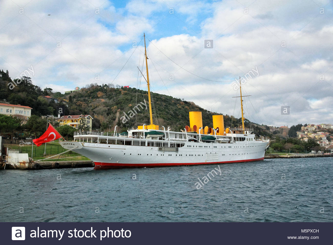 Istanbul, Turkey-December 12, 2015 -A beautiful white ship with yellow pipes and a Turkish flag on the rostrum is - Stock Image