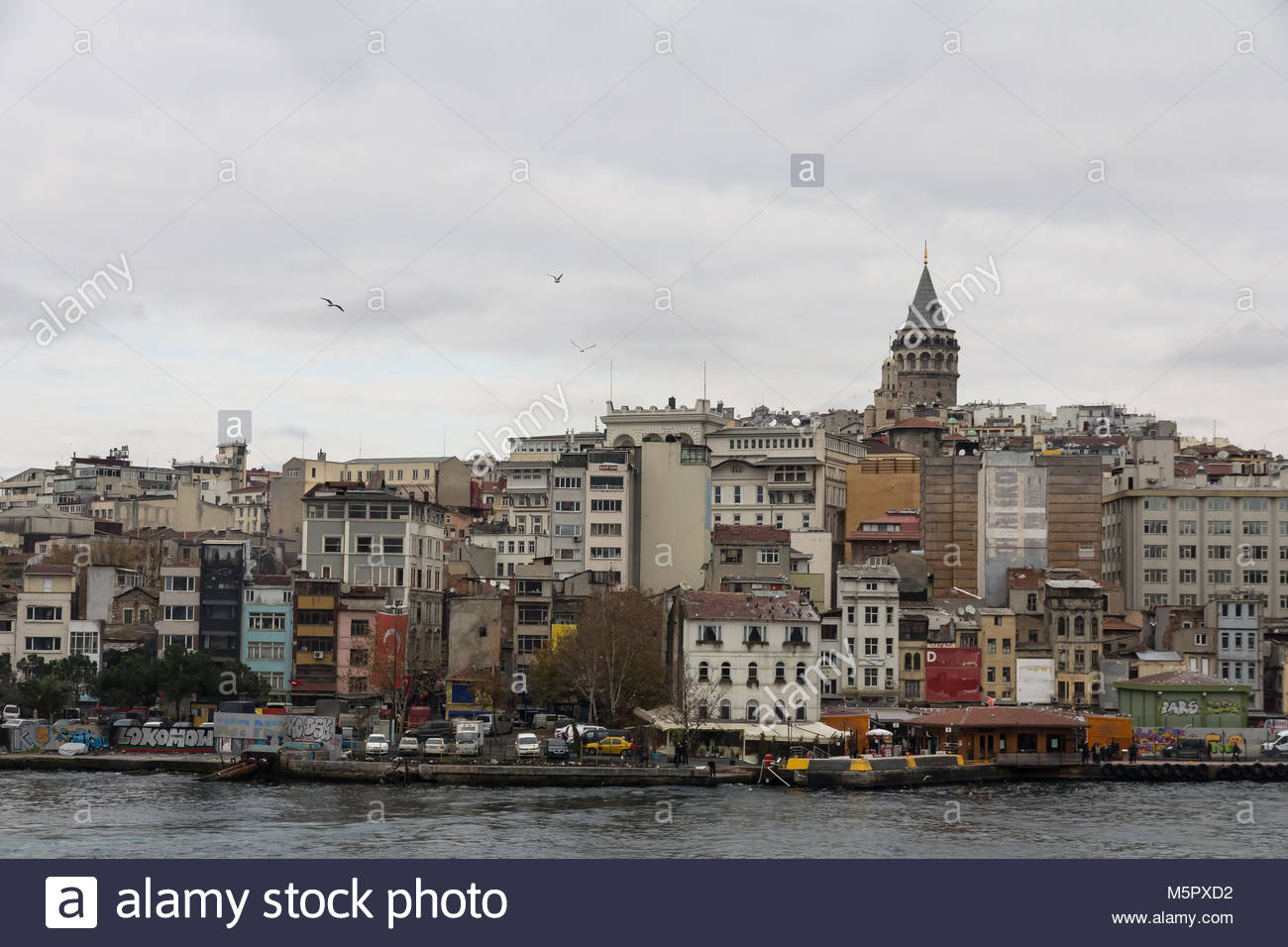 Istanbul, Turkey-December 12, 2015 -View of the Galata tower and moorage on the strait of the strait of the Turkish - Stock Image