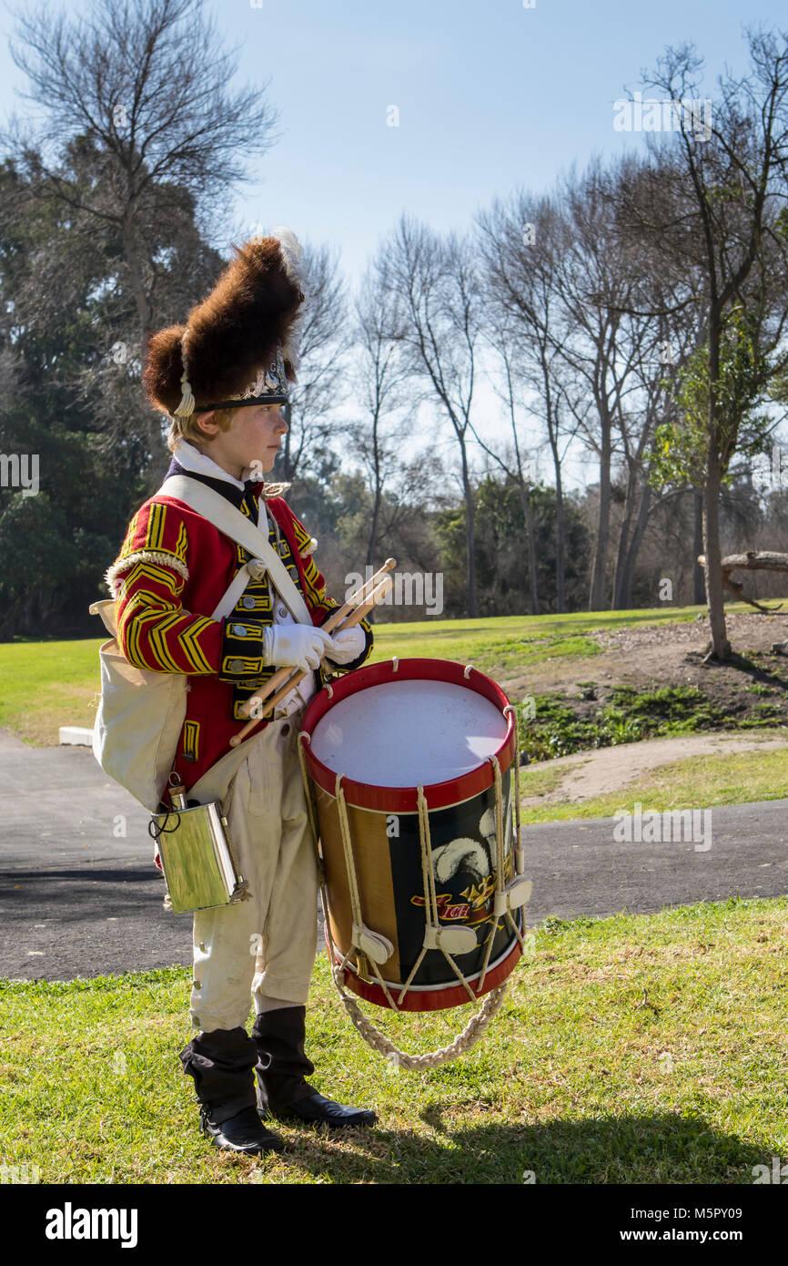 British drummer boy dressed in authentic British uniform at