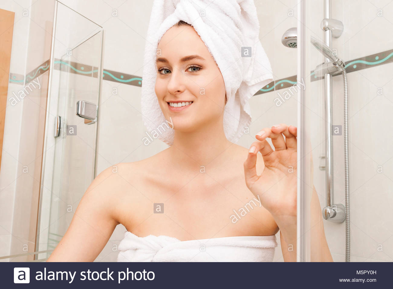 Smiling Fresh Woman Inside the Shower Cubicle - Stock Image
