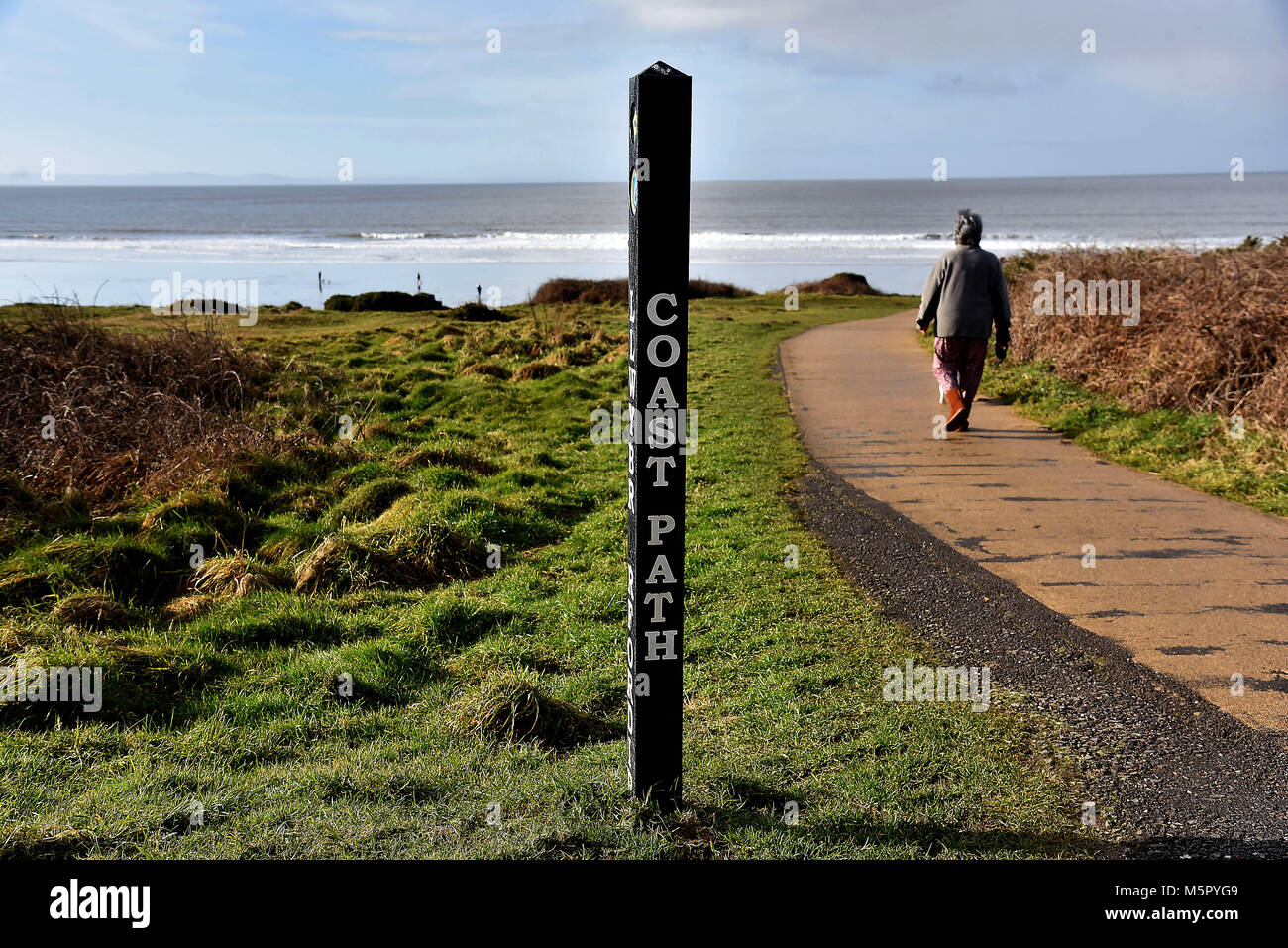 Pictures show the Wales Coas tPath and the Royal Porthcawl Golf Club which runs adjacent to the Coast  Path at Porthcawl - Stock Image