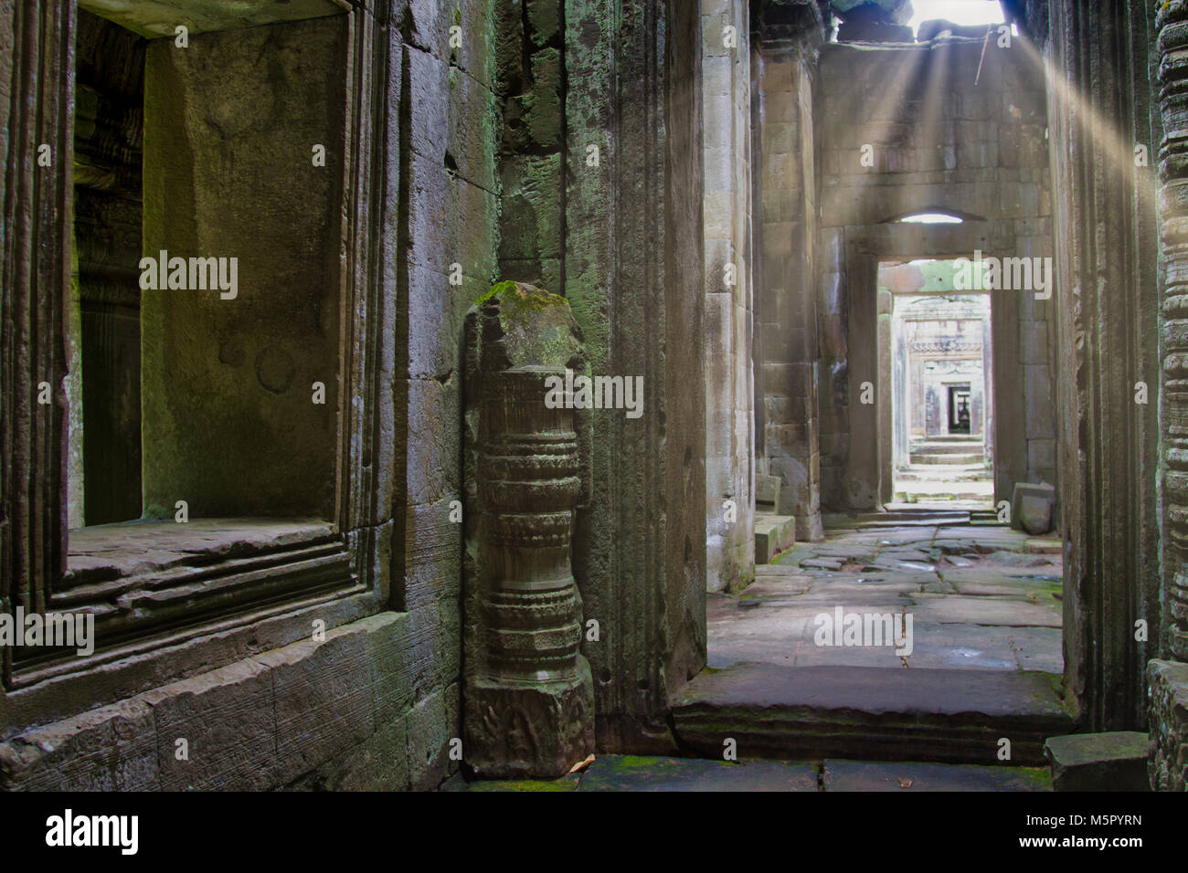 Sun Rays illuminate a passageway at Angkor Was, a UN World Heritage site in Cambodia. - Stock Image