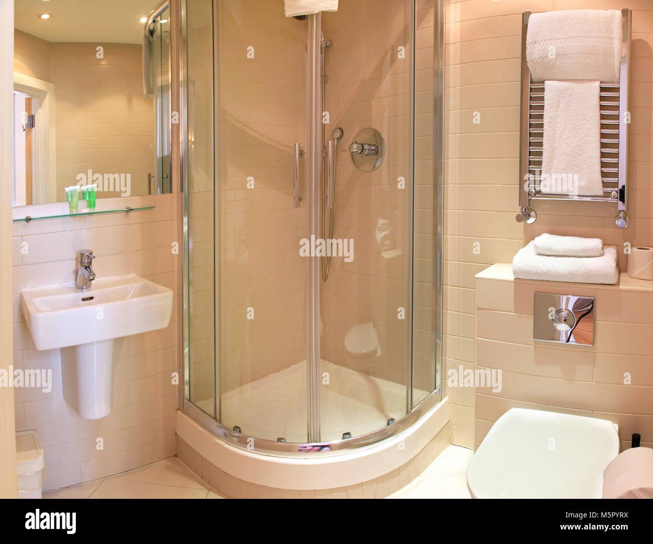 Minimalistic bathroom interior with glass shower cabin Stock Photo ...