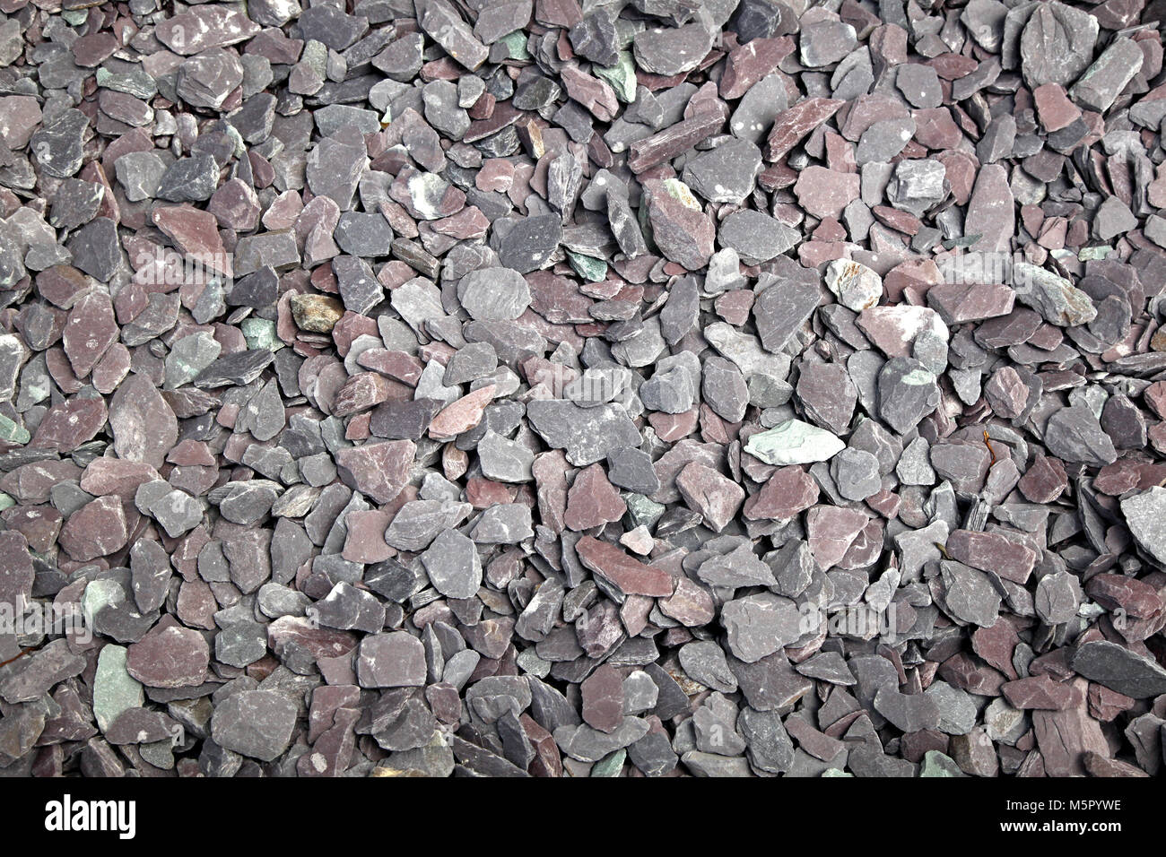 Background texture of small gray pointy stones - Stock Image