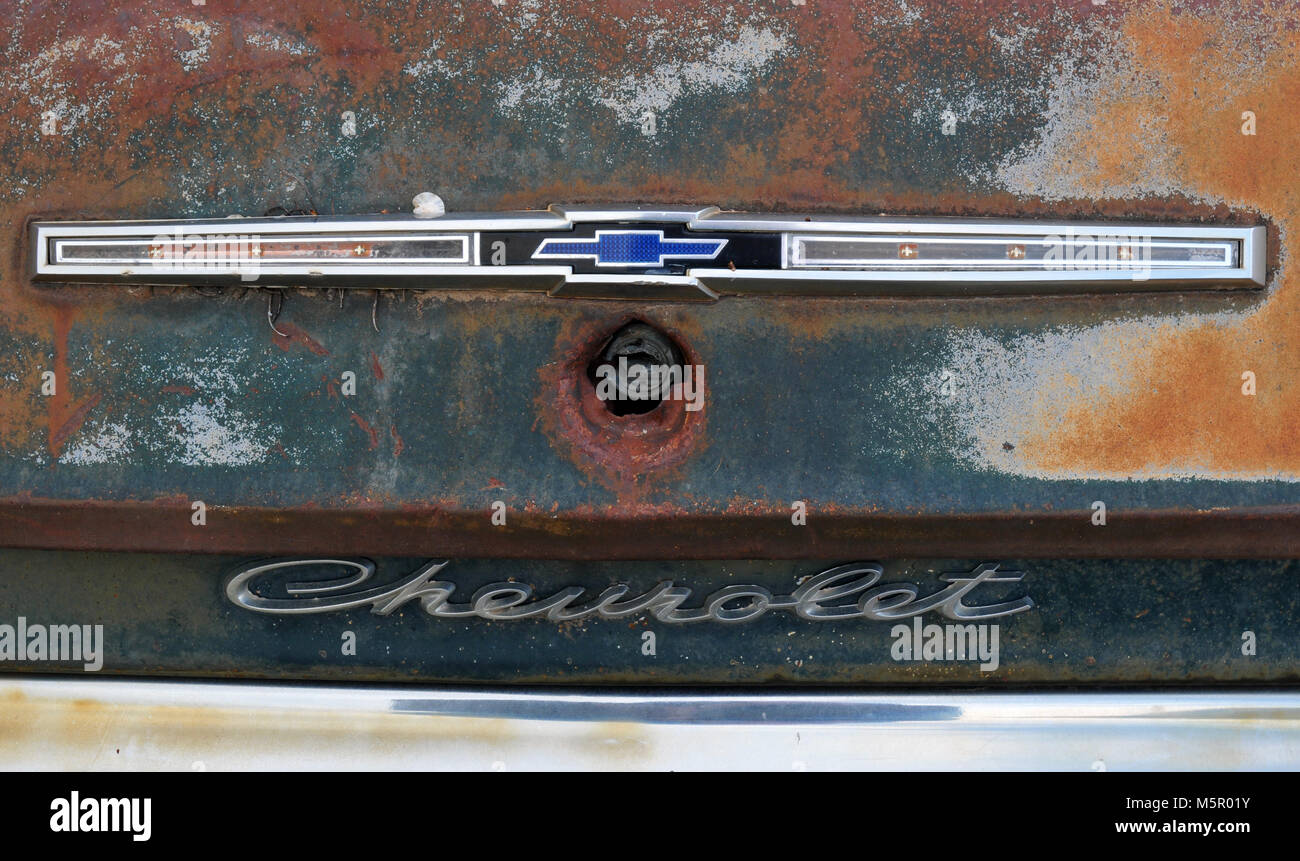 Detail of the trunk emblem of a rusting Chevrolet along old Route 66. - Stock Image