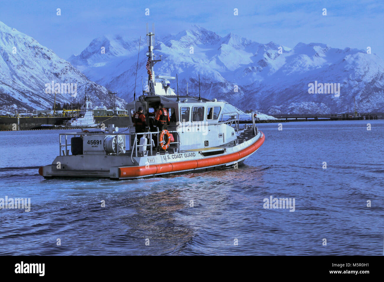 Coast Guard members assigned to the U.S. Coast Guard Station Valdez head back to station after recovering hazardous Stock Photo
