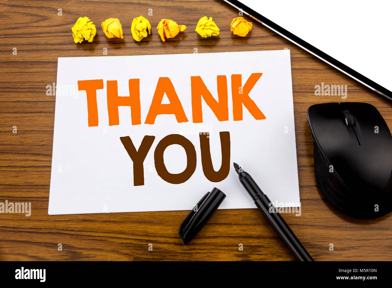 Conceptual hand writing text showing Thank You. Business concept for Gratitude Thanks written on sticky note paper - Stock Image