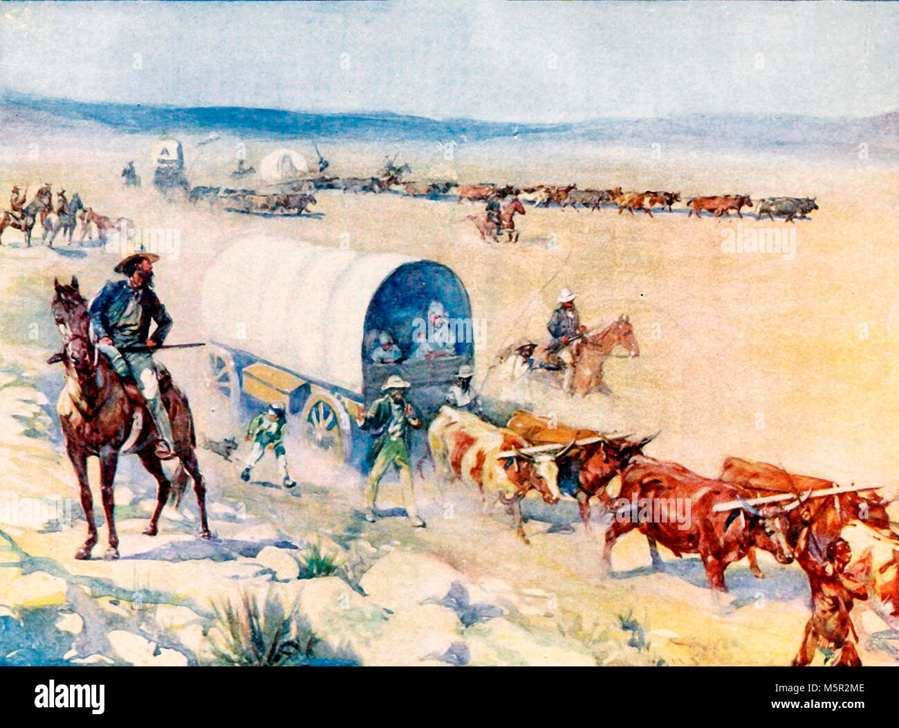 The bullock waggons wound slowly over the billowy plains - Stock Image