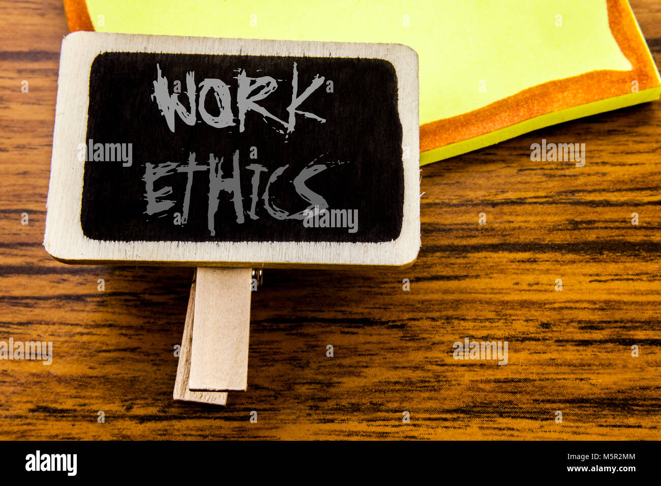 Handwritten text showing Work Ethics. Business concept for Moral Benefit Principles written on announcement board Stock Photo