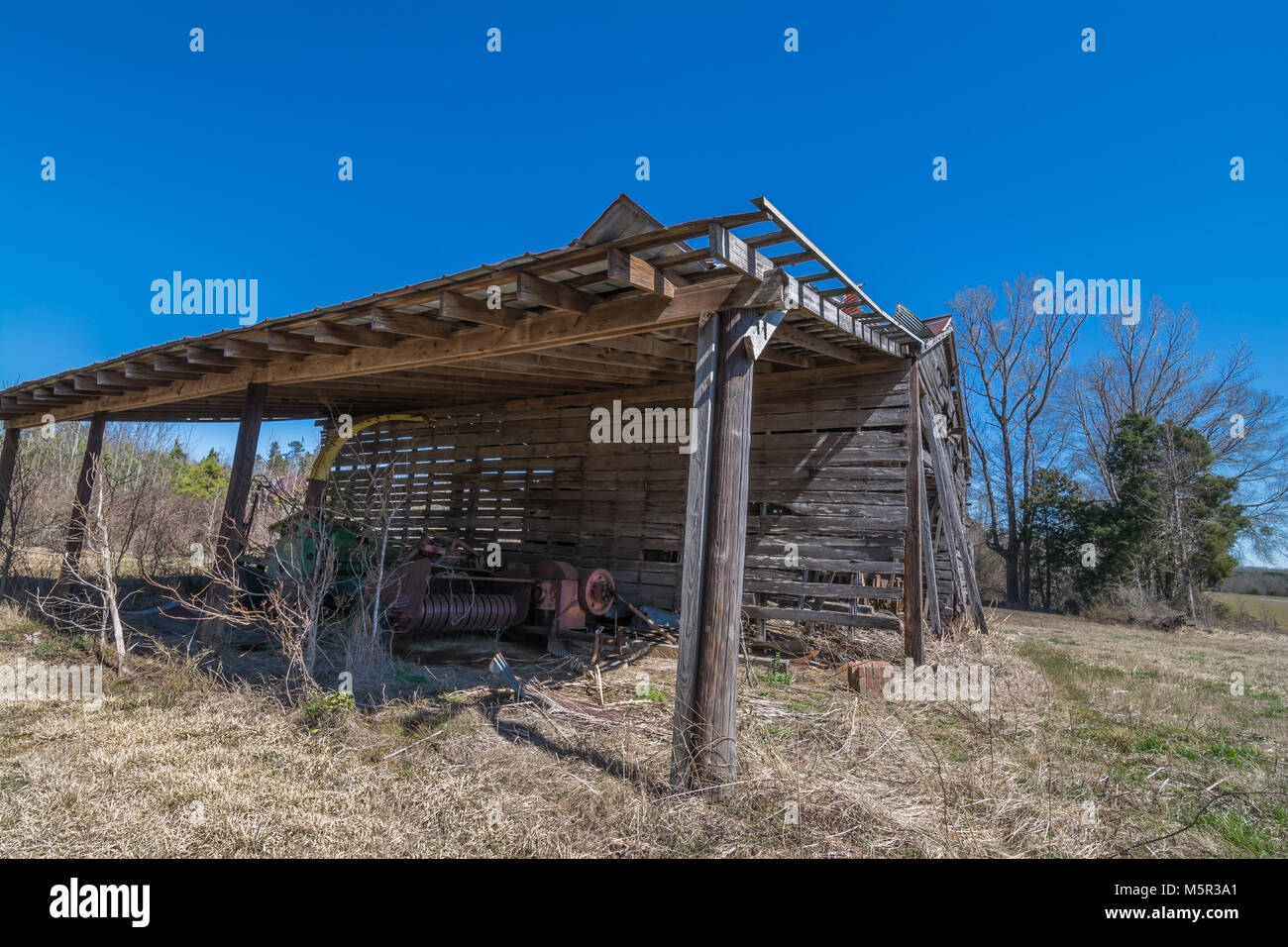 An old barn about to fall down. - Stock Image