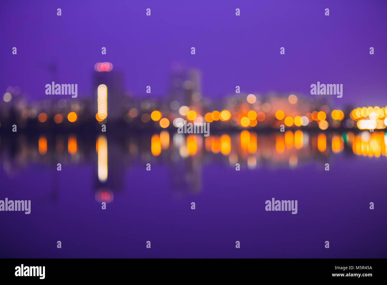 Abstract Blurred Bokeh Architectural Urban Backdrop With Reflections In Water. Real Blurred Colorful Bokeh Background - Stock Image