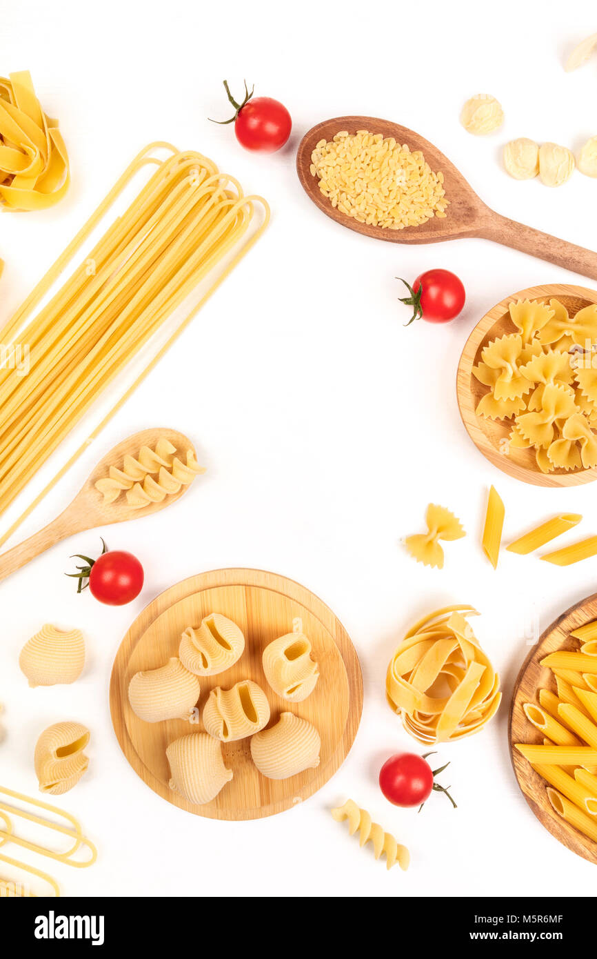 Overhead photo of different types of pasta on white, forming frame - Stock Image