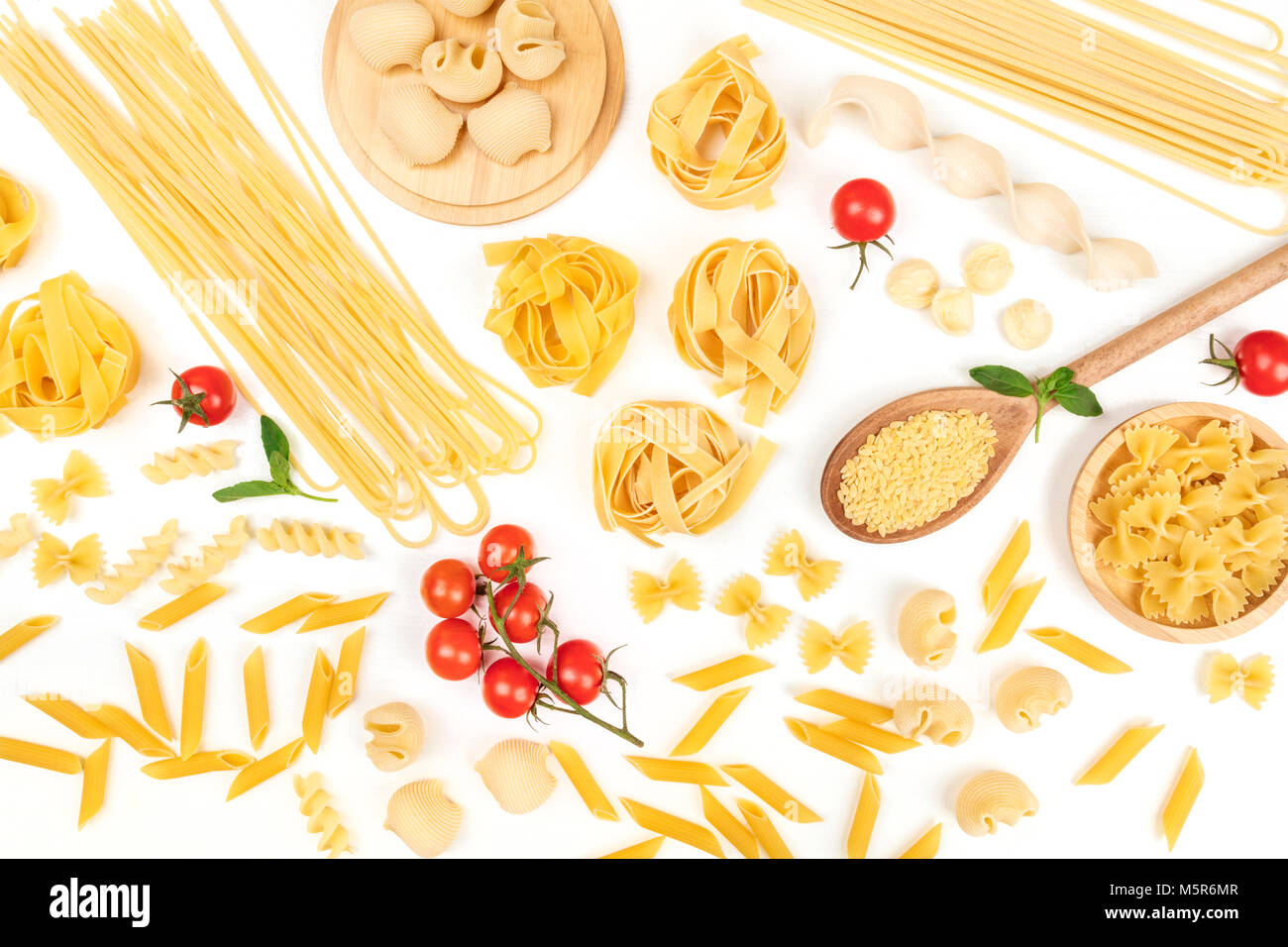 Overhead photo of different types of pasta on white Stock Photo