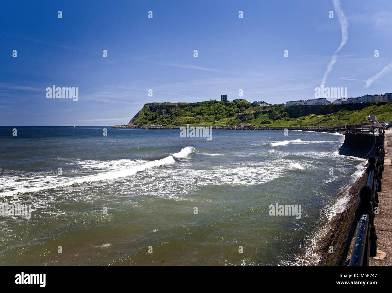 Scarborough Castle stands on a promontory between the North and South Bays. This view is from the North Bay looking - Stock Image