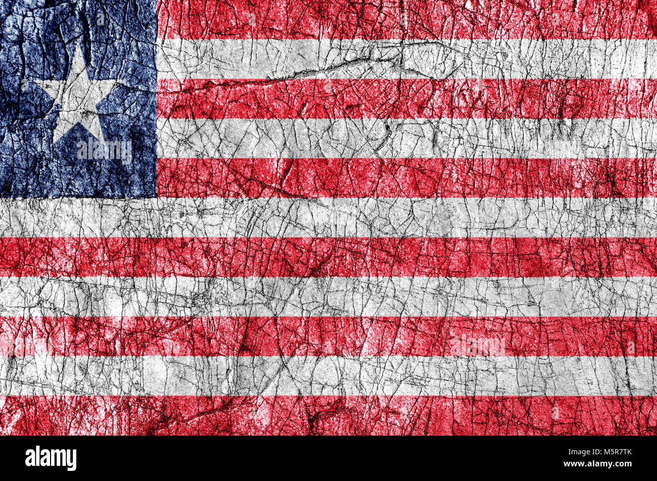 Grudge stone painted Liberia flag - Stock Image