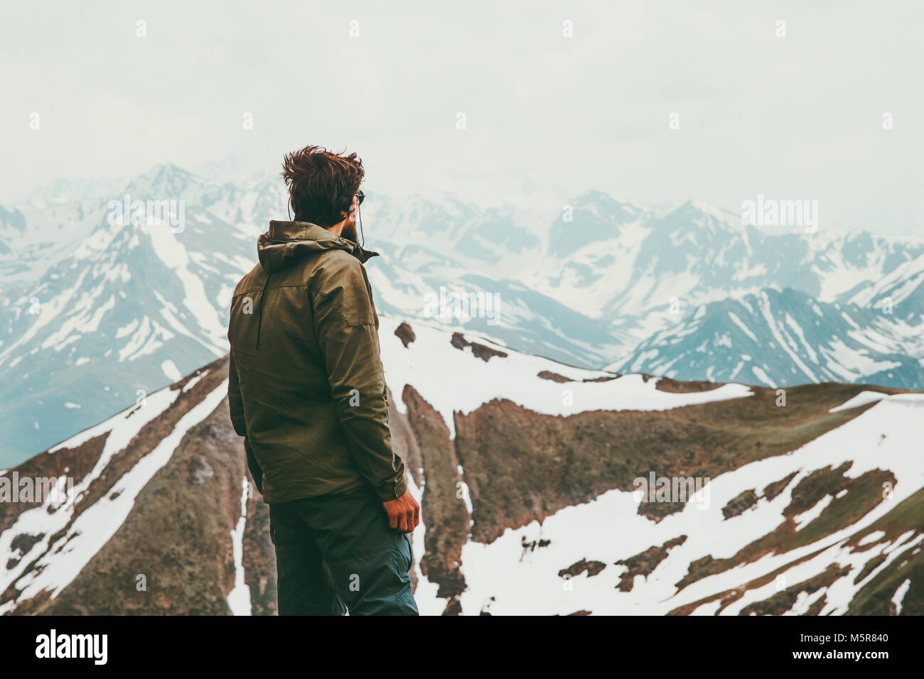 Man traveler alone wander mountains landscape Travel Lifestyle concept adventure outdoor active vacations trekking - Stock Image