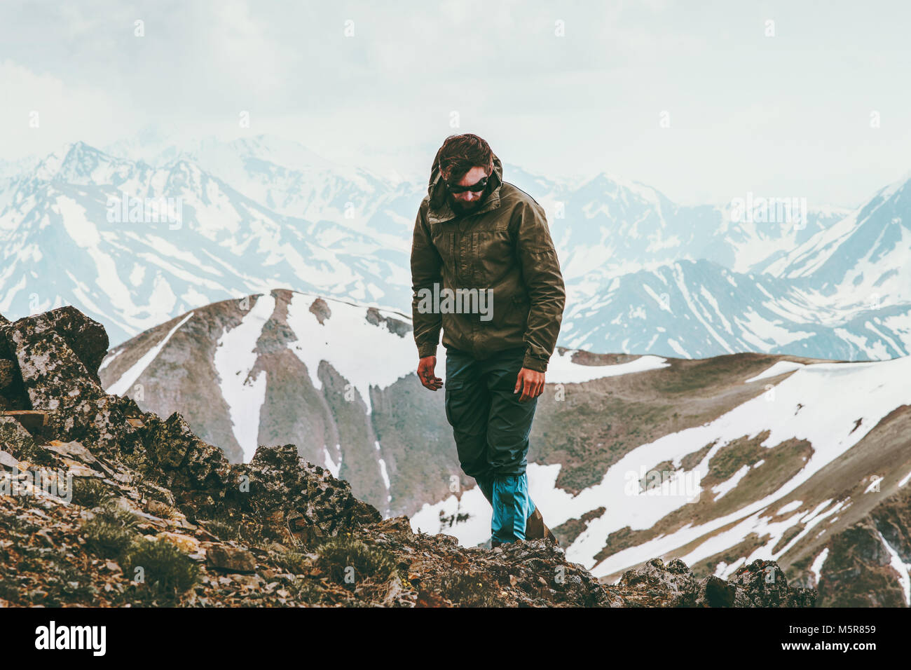 Mountains Hiking Man Travel Lifestyle concept adventure outdoor active vacations trekking sport wild nature - Stock Image