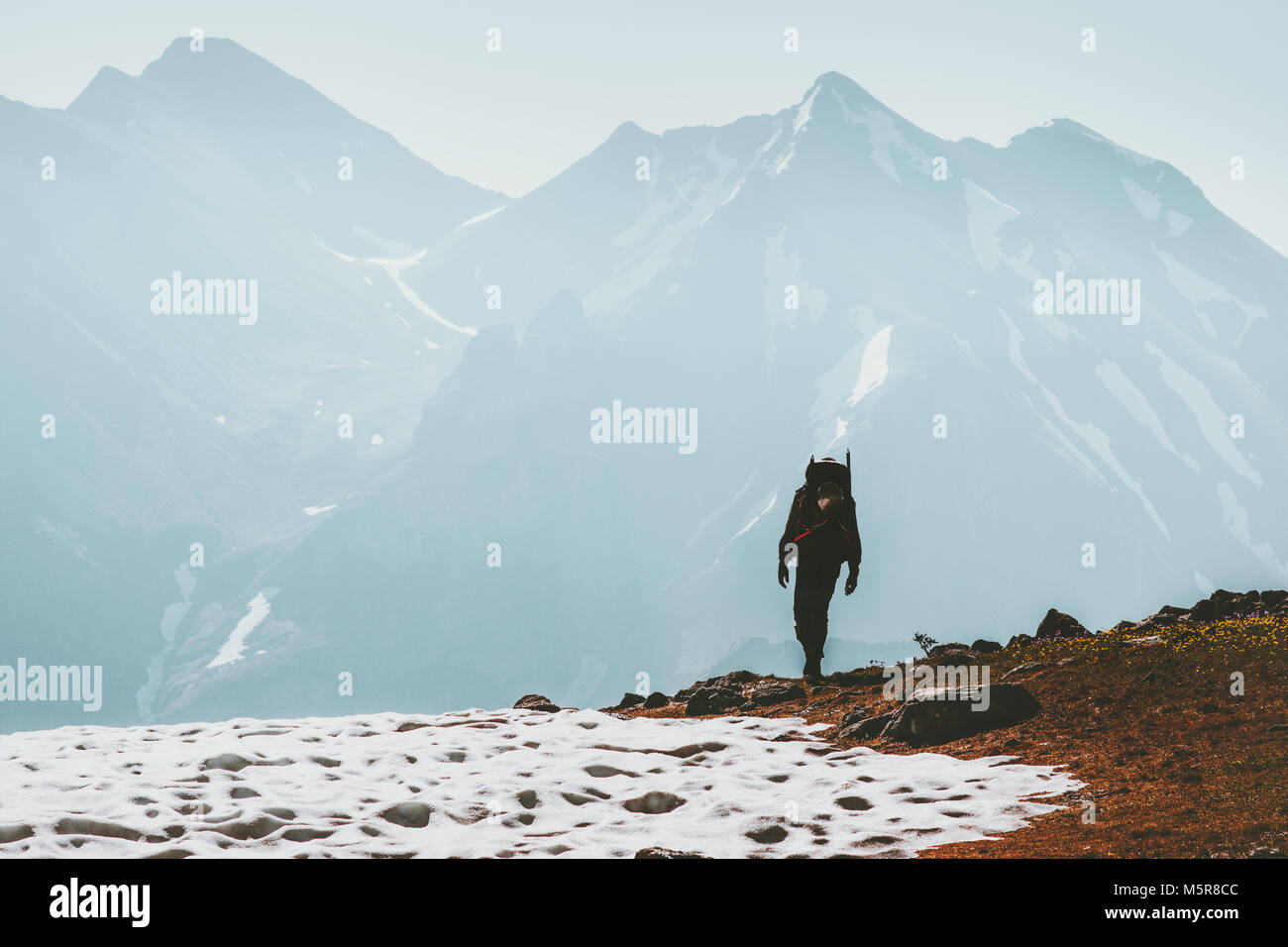 Traveler Man hiking in mountains Lifestyle  travel survival concept adventure outdoor active vacations climbing - Stock Image