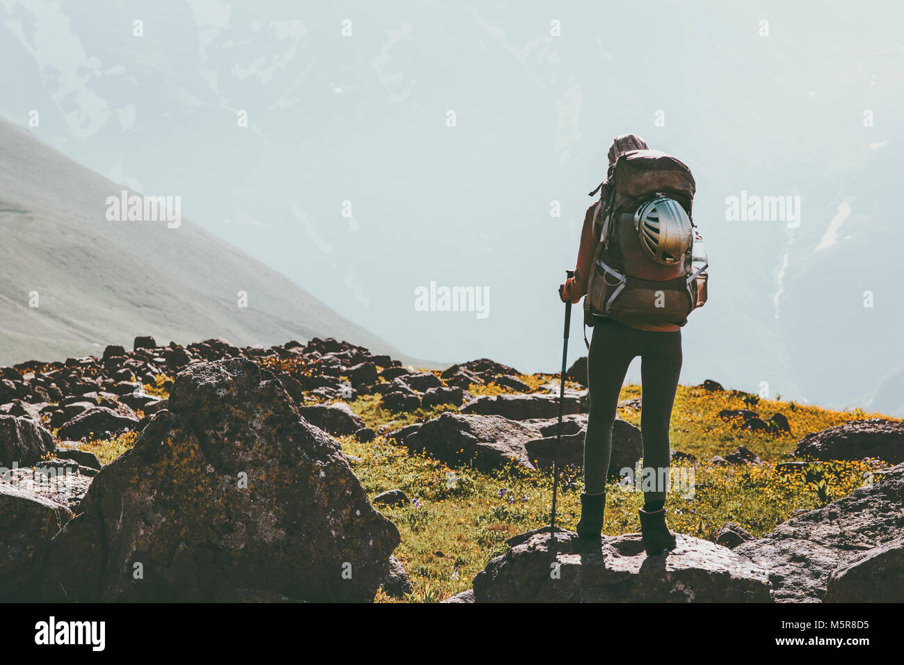 Adventure Travel vacations in mountains woman hiking with backpack healthy lifestyle concept outdoor mountaineering - Stock Image