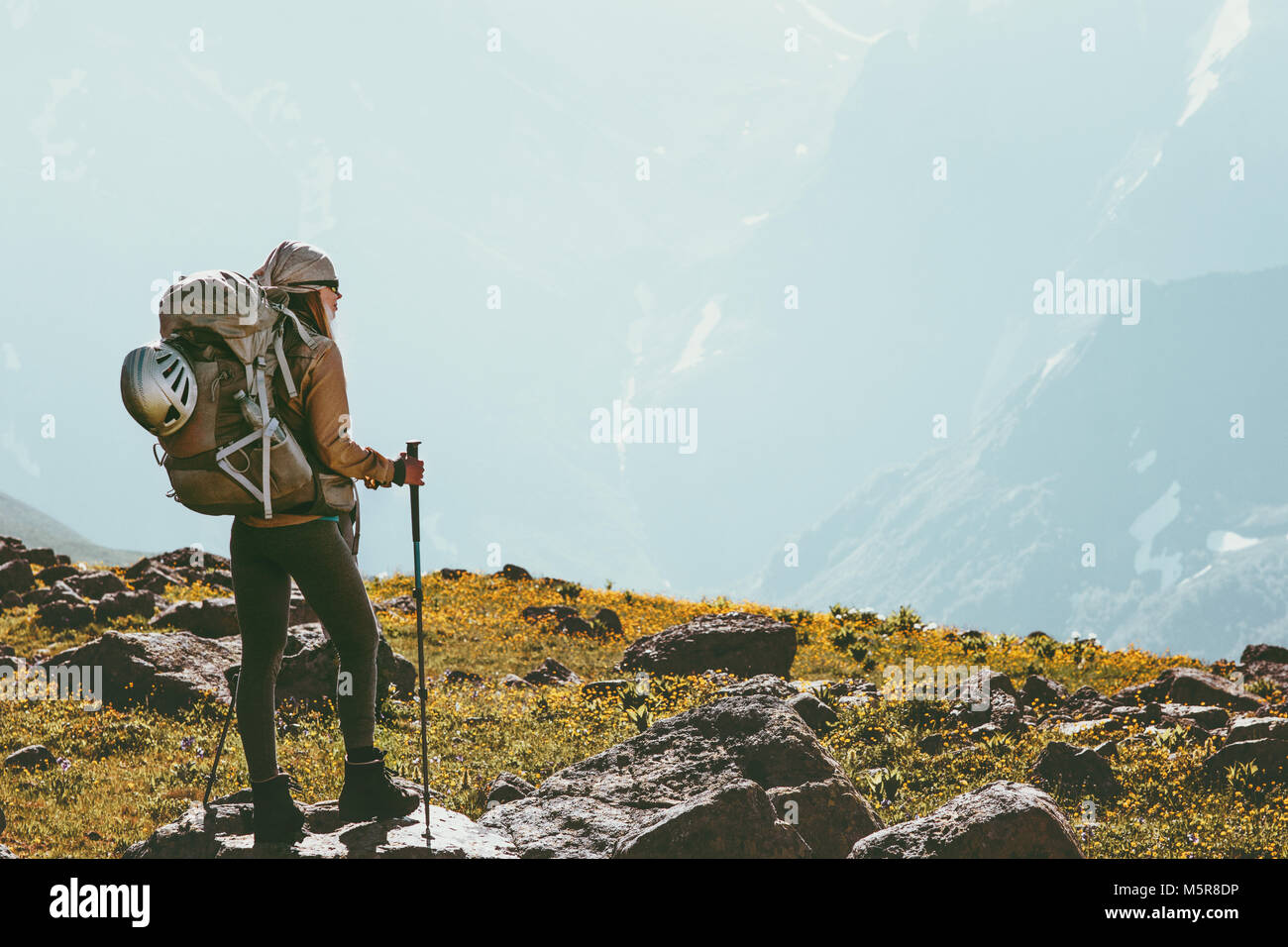 Woman trekking with backpack adventure Travel healthy Lifestyle concept outdoor active summer vacations - Stock Image