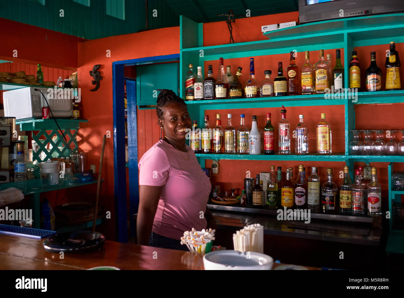 Black Barmaid Offers A Cocktail At The Bar Counter In A Small Stock Photo Alamy