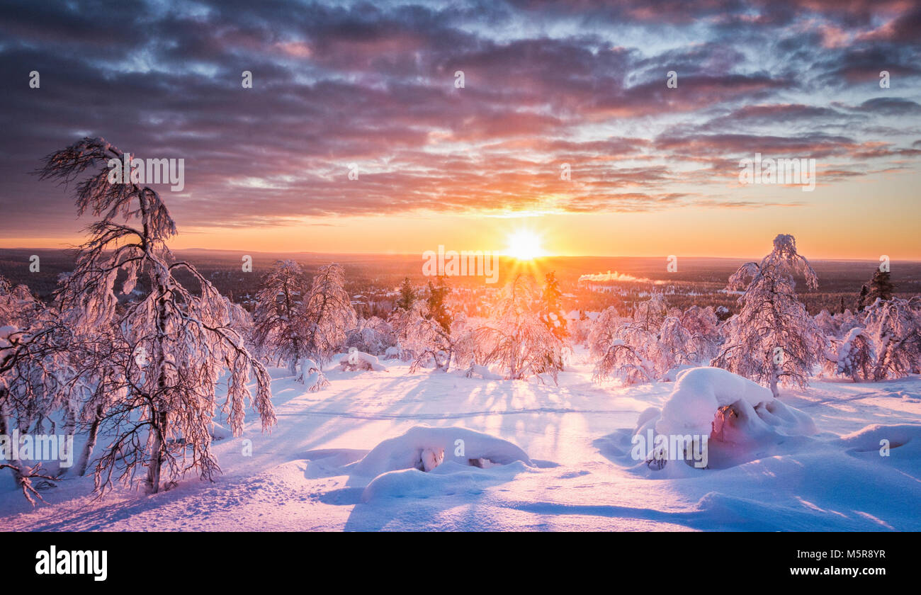Panoramic view of beautiful winter wonderland scenery in scenic golden evening light at sunset with clouds in Scandinavia, - Stock Image