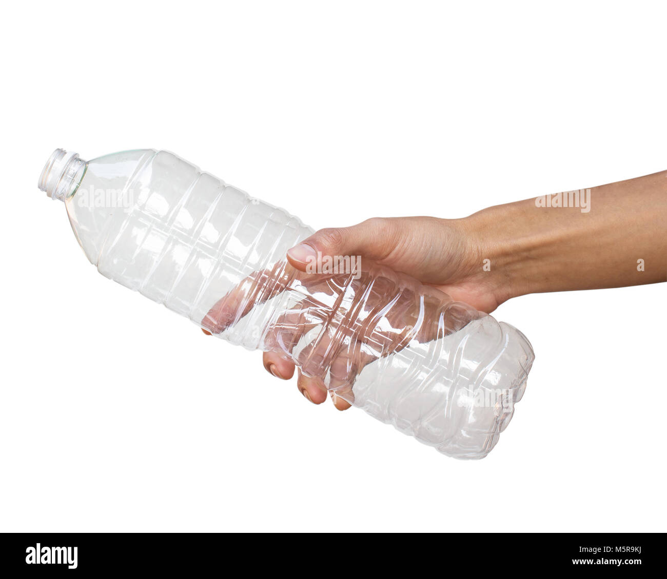 A man hand holding clear water bottle isolated on white background with clipping path. Water bottle in human hand. - Stock Image
