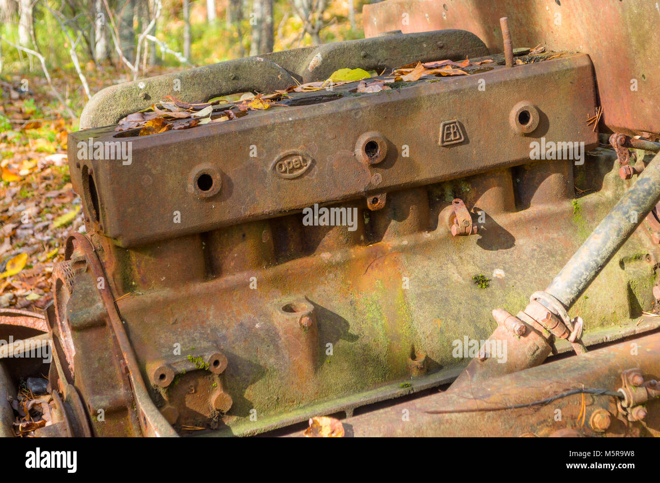 Rusty remains of destroyed wrack of old Opel halftruck car, used in now abandoned feldspat mine. Evje, central Norway. - Stock Image