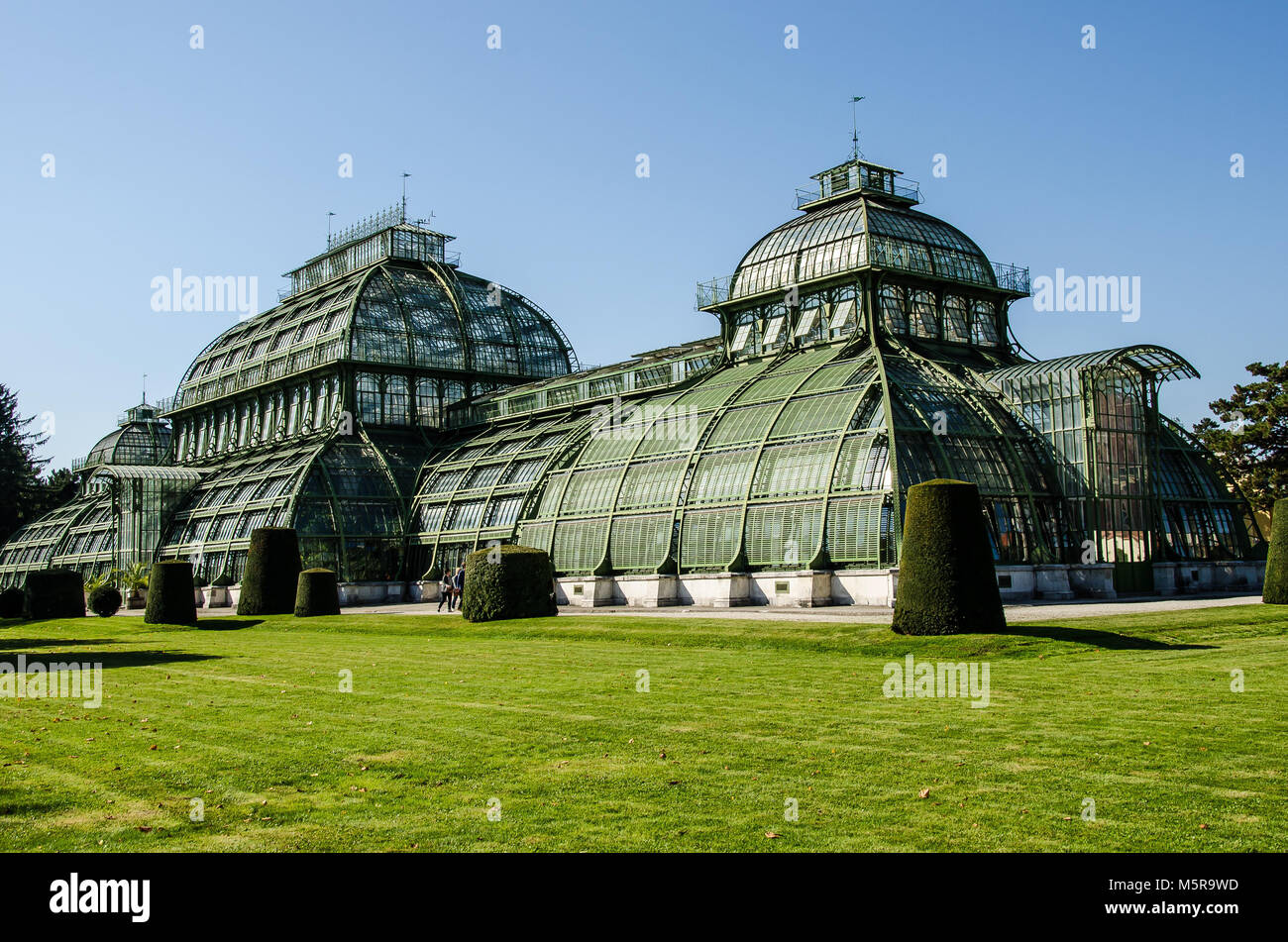 The Palmenhaus in the Schönbrunn Palace gardens is one of the last of its kind; a giant steel and glass construction - Stock Image