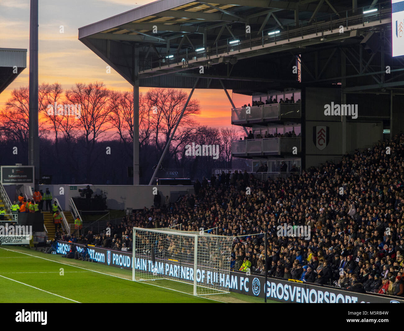 A lovely sunset at Craven Cottage prior to the start of a match - Stock Image