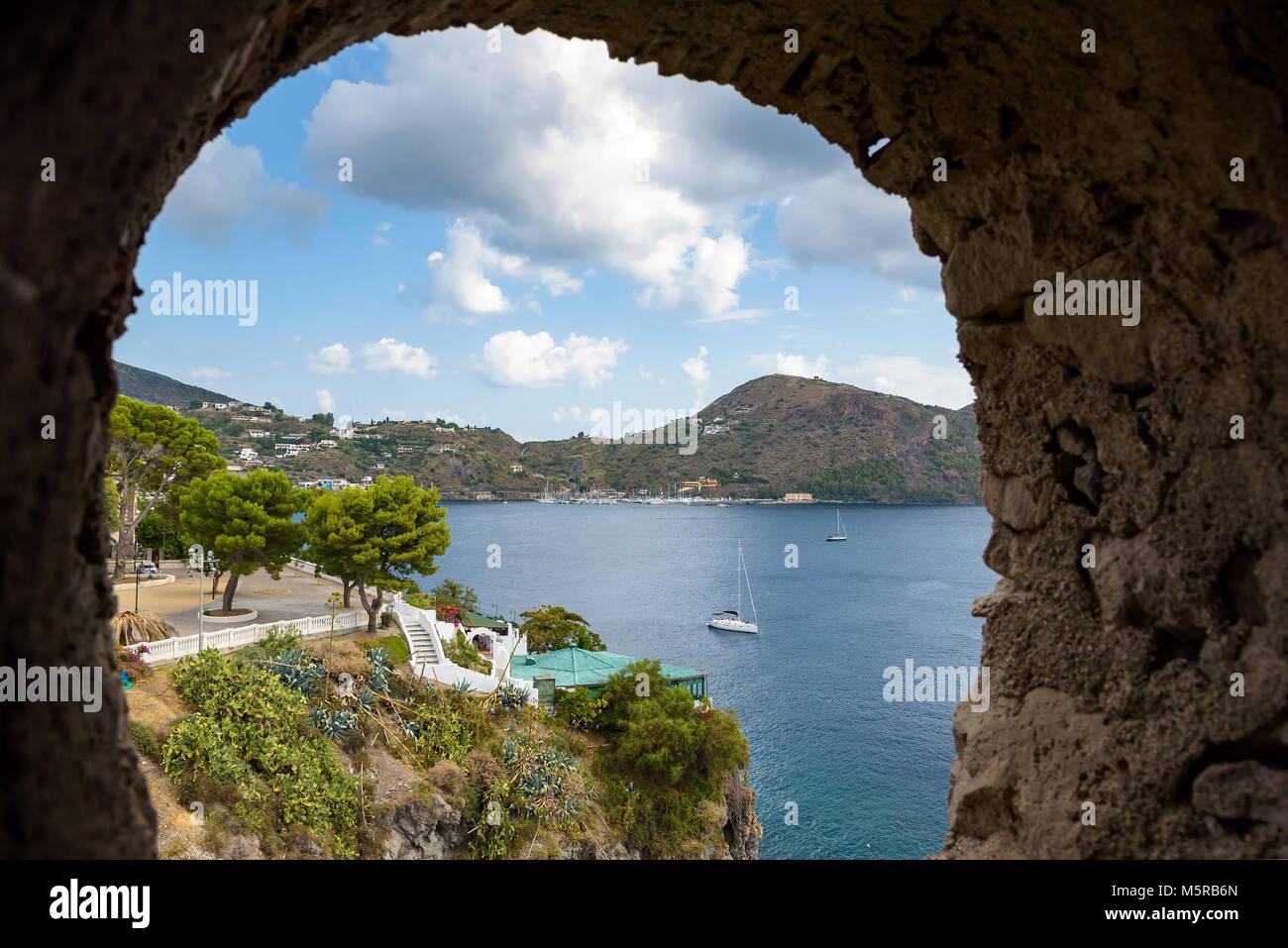 Lipari Island coast seen through the stone window, Aeolian Islands, Italy Stock Photo