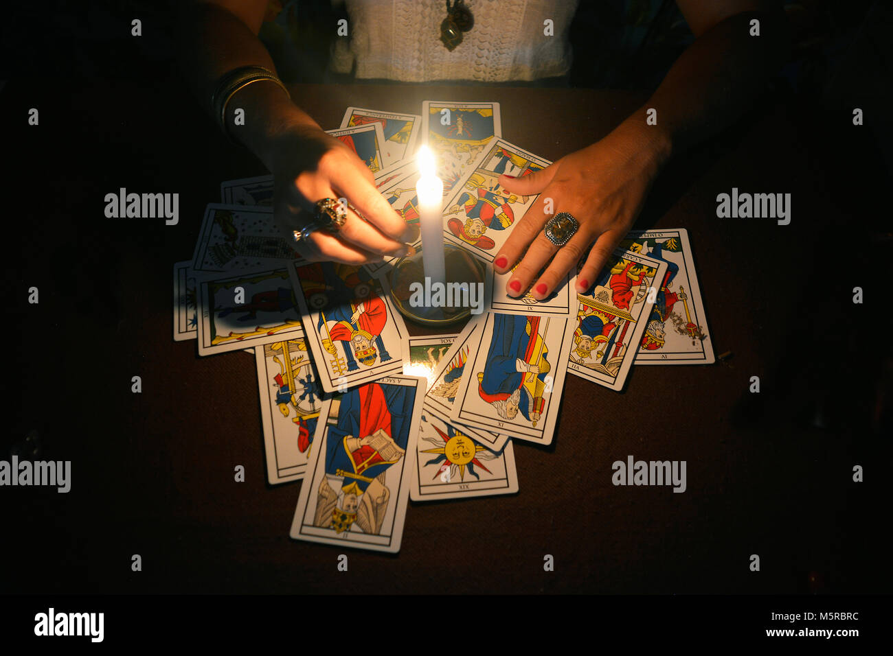 Tarot cards on table with candle - Stock Image