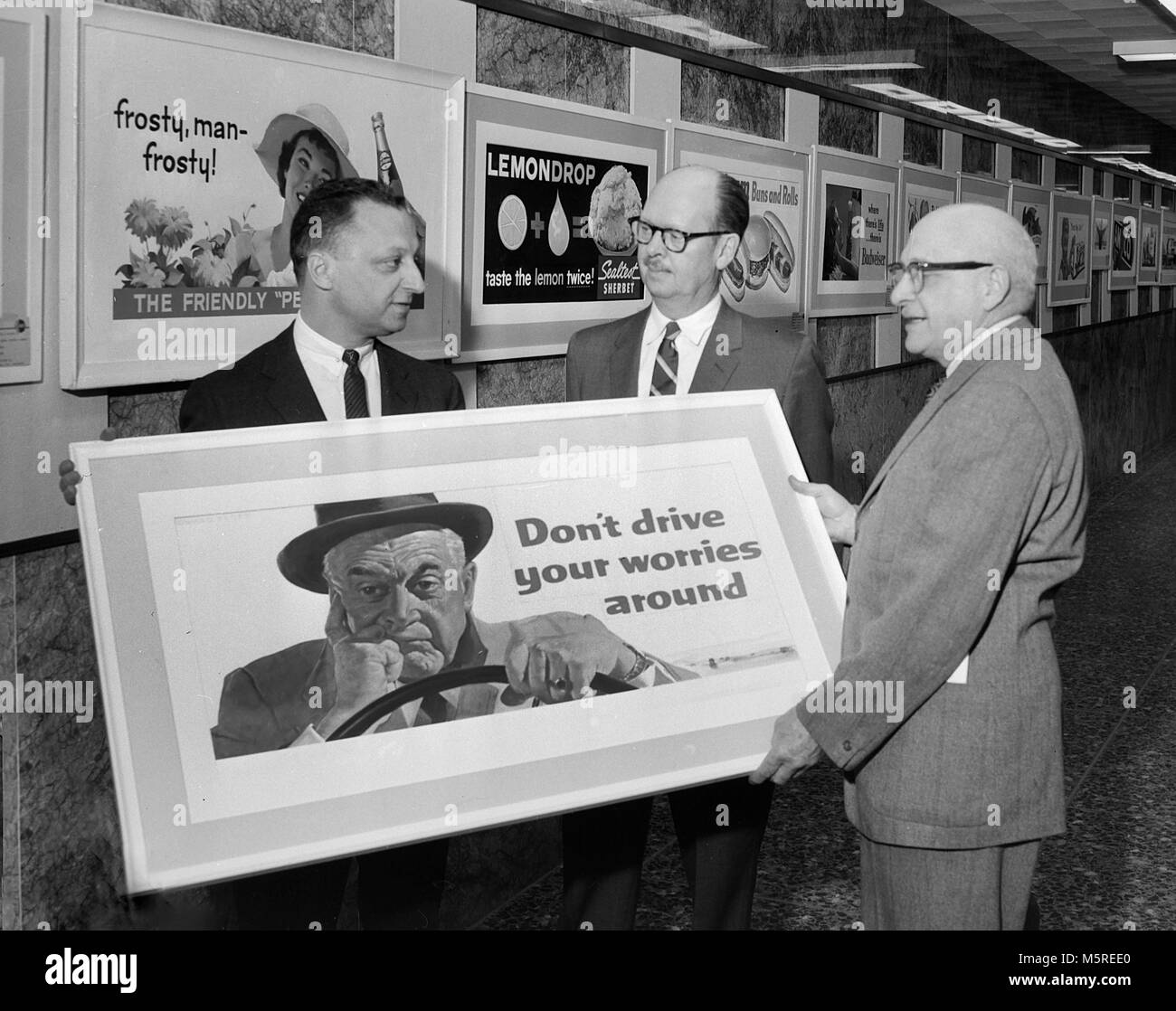 State employees display a public service message on a billboard to promote traffic safety in Chicago, 1960. - Stock Image