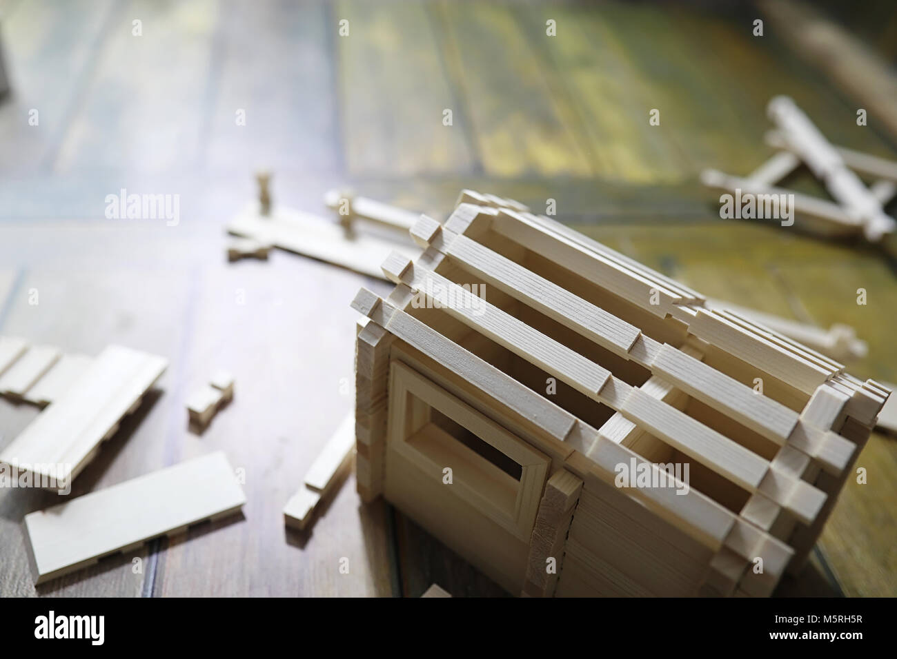 Toy wooden house. The constructor is made of natural wood for ch - Stock Image