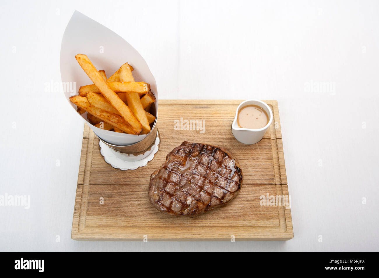 Rib Eye and Chips. The Bar and Grill, 21 James Street South, Belfast, BT2 7GA. Photograph/Paul McErlane - Stock Image