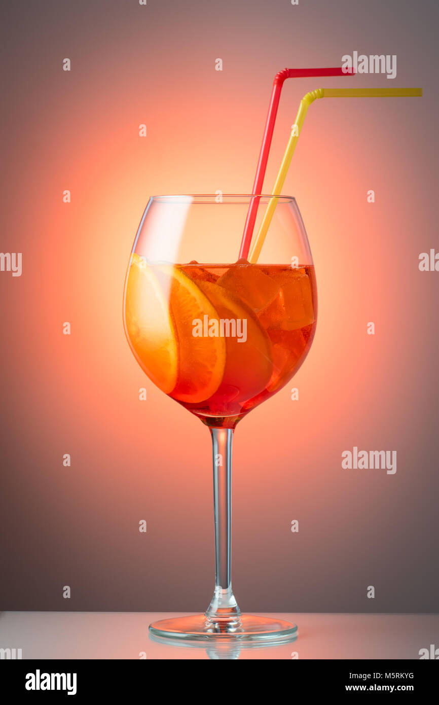 Summer refreshing faintly alcoholic cocktail Aperol spritz in a  - Stock Image