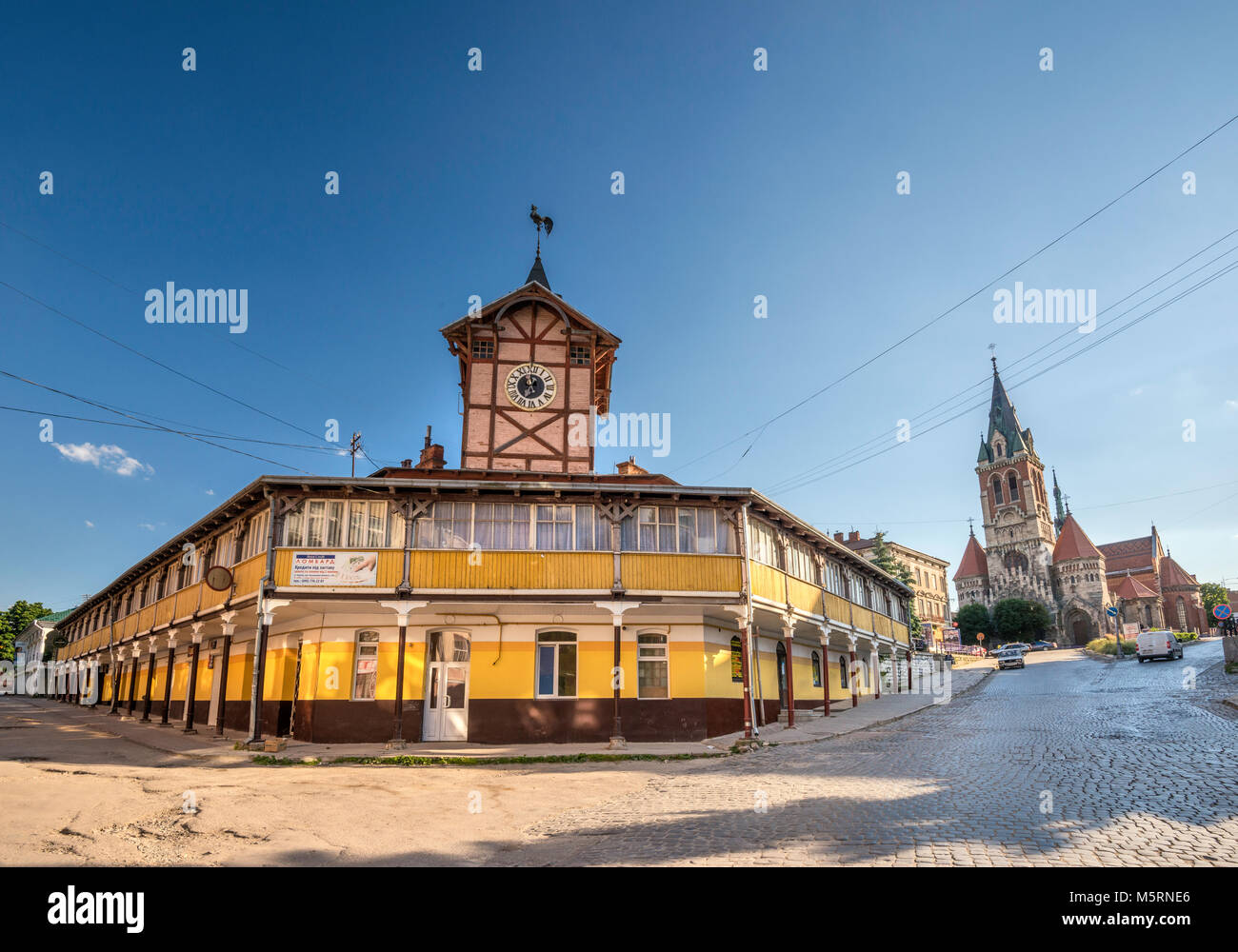 Town Hall and Polish Roman Catholic Church of Saint Stanislaus in Chortkiv, Ternopil Oblast, Ukraine Stock Photo
