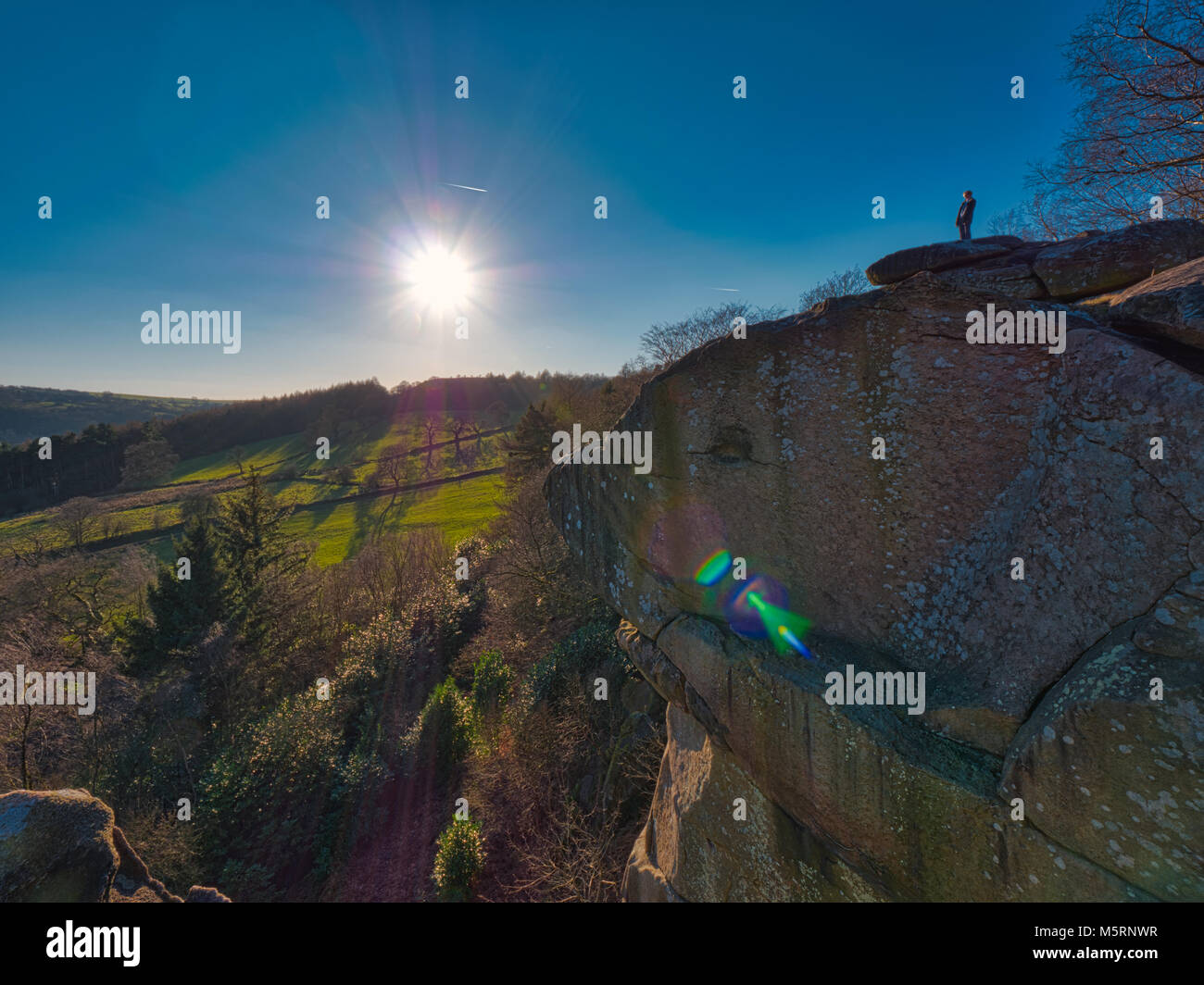 Peak District, Derbyshire, UK. 25th February, 2018. UK Weather man admiring the cold clear blue sky's & - Stock Image