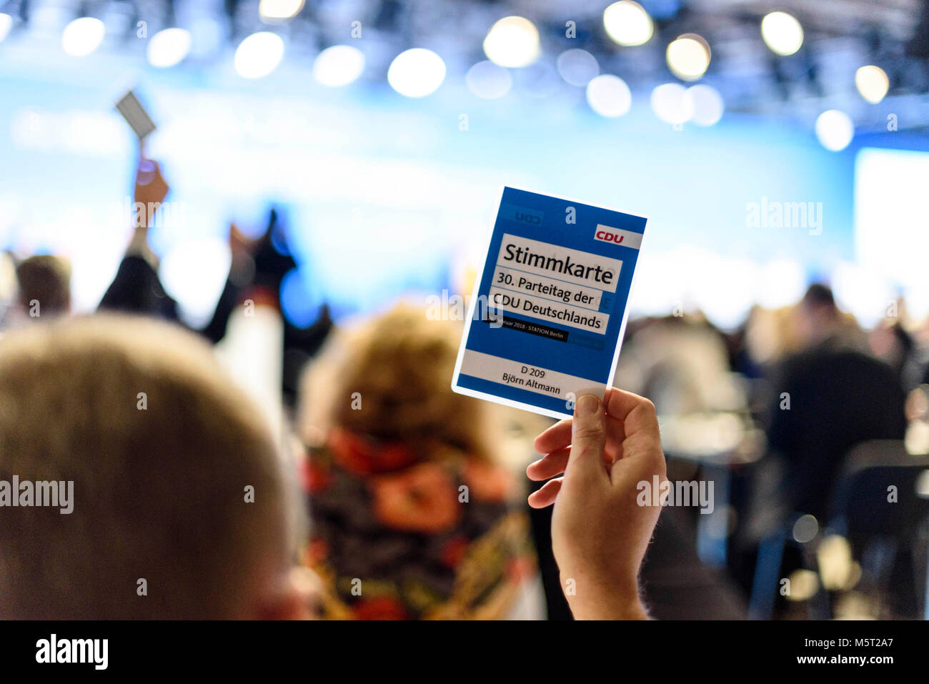Berlin, Germany. 26th Feb, 2018. A party member votes during the 30th Congress of the CDU with a voting card. The - Stock Image