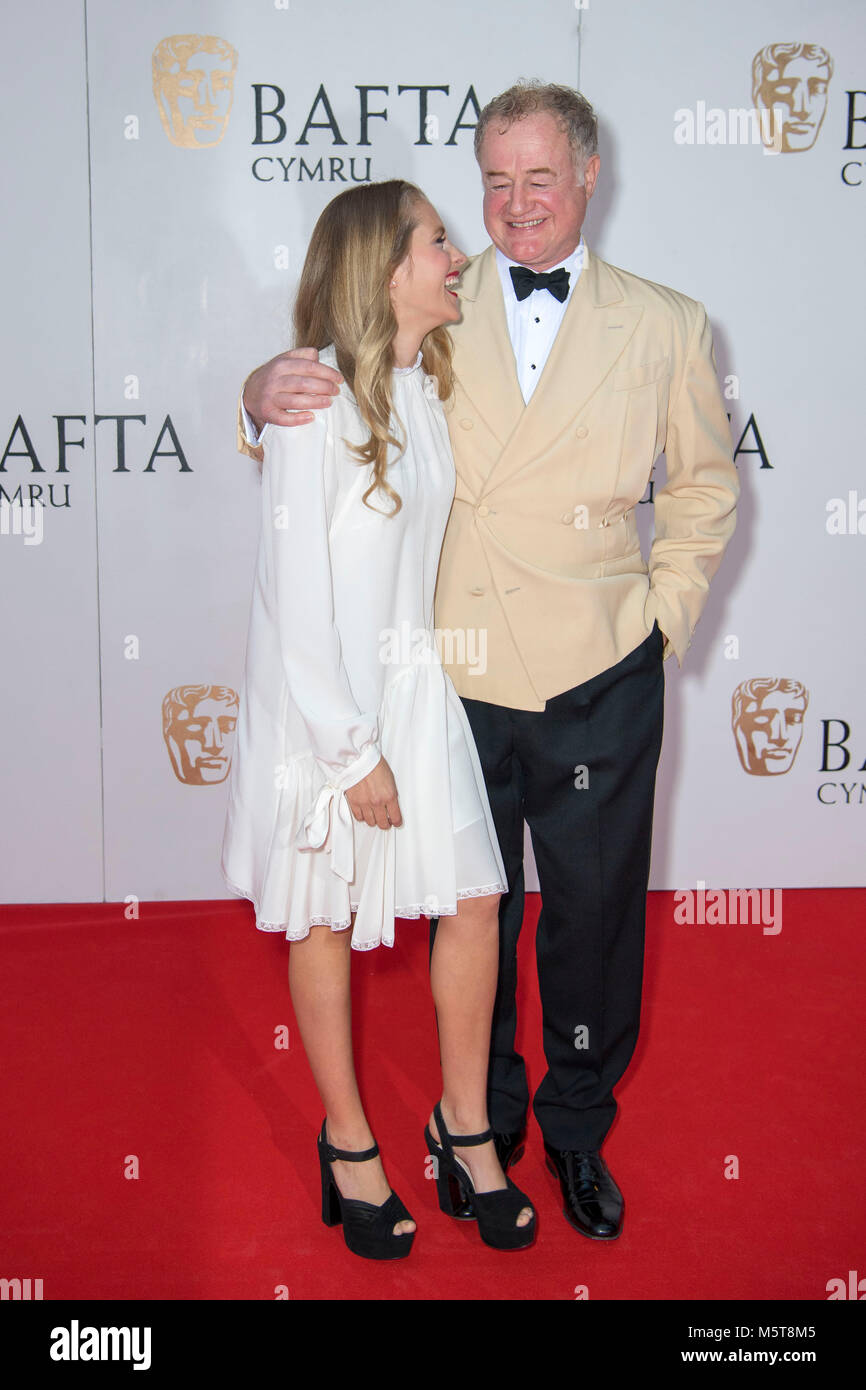 Teresa Palmer and Owen Teale laugh while posing for a picture at the 26th British Academy Cymru Awards held at St - Stock Image
