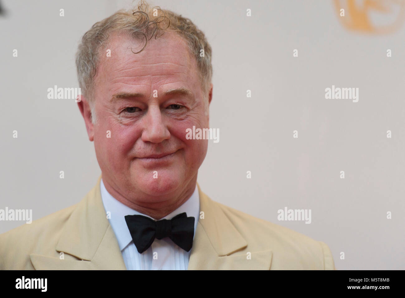 Actor Owen Teale poses for a picture at the 26th British Academy Cymru Awards held at St David's Hall on October - Stock Image