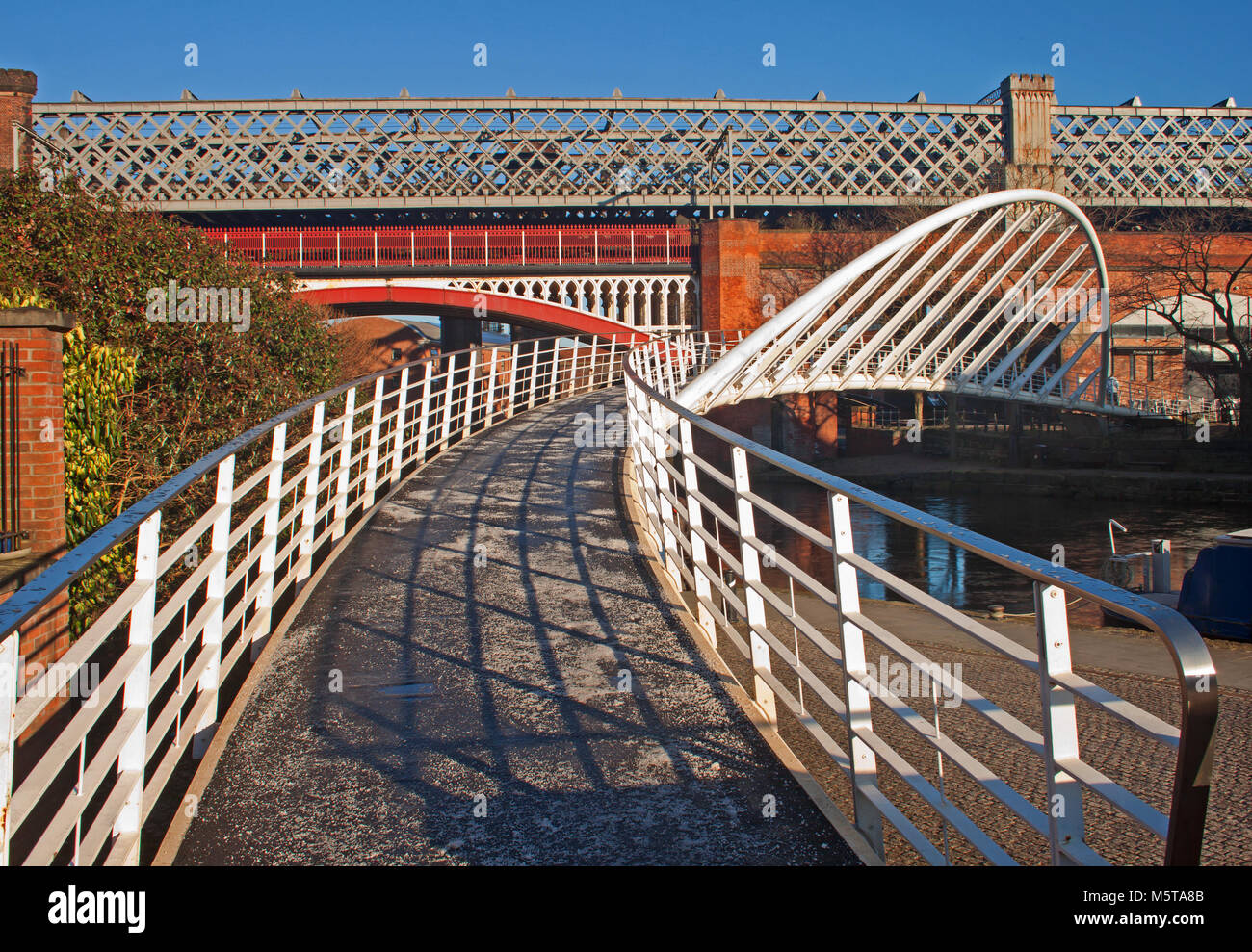Bridges of Castlefield, Manchester, with Merchant's bridge leading the eye to the historic railway bridge - Stock Image