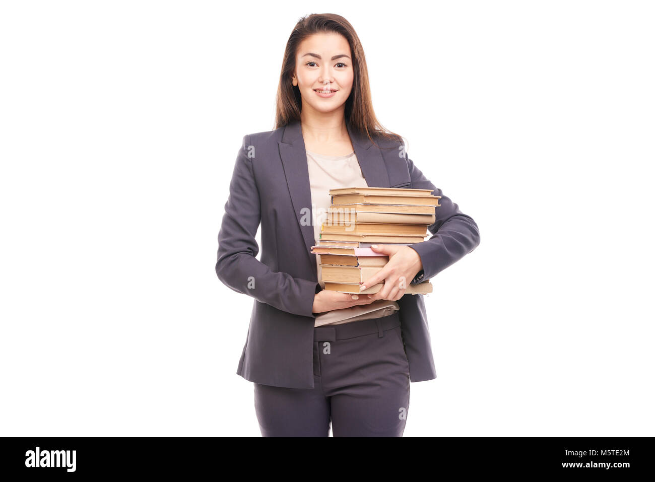 Businesswoman with books - Stock Image