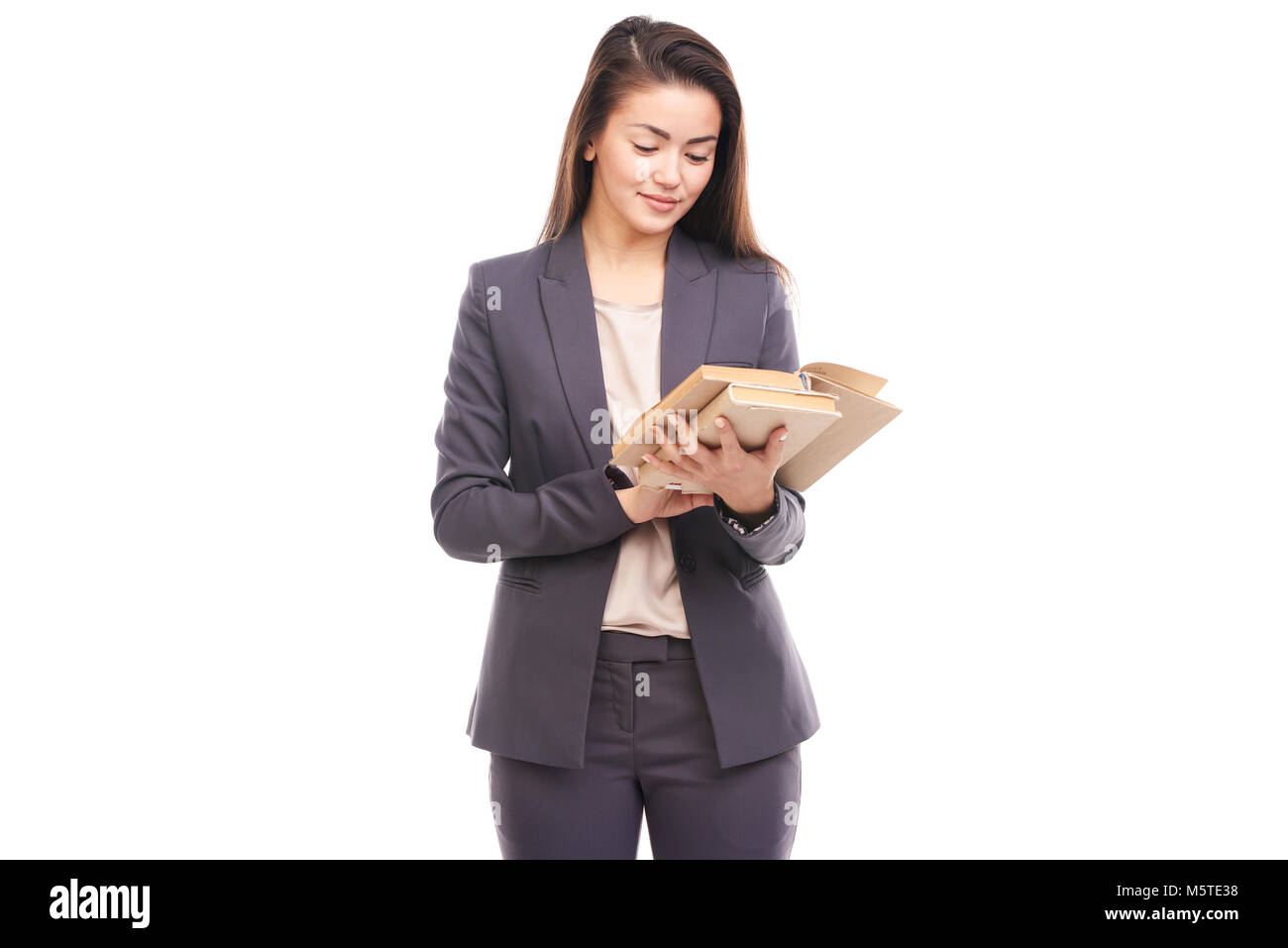 Businesswoman with book - Stock Image
